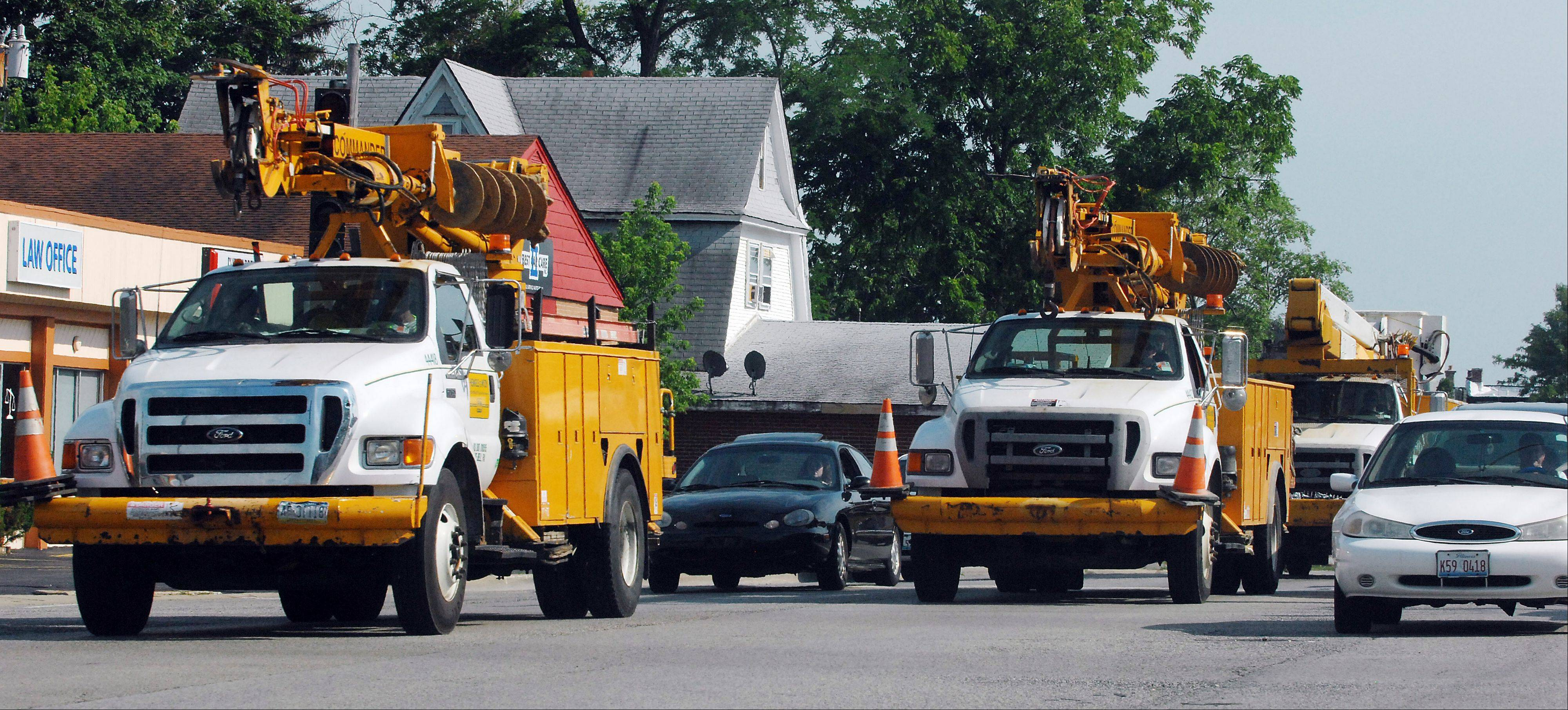 Utility trucks head north into Lake County on Route 45 Saturday, to finish getting the power back on.
