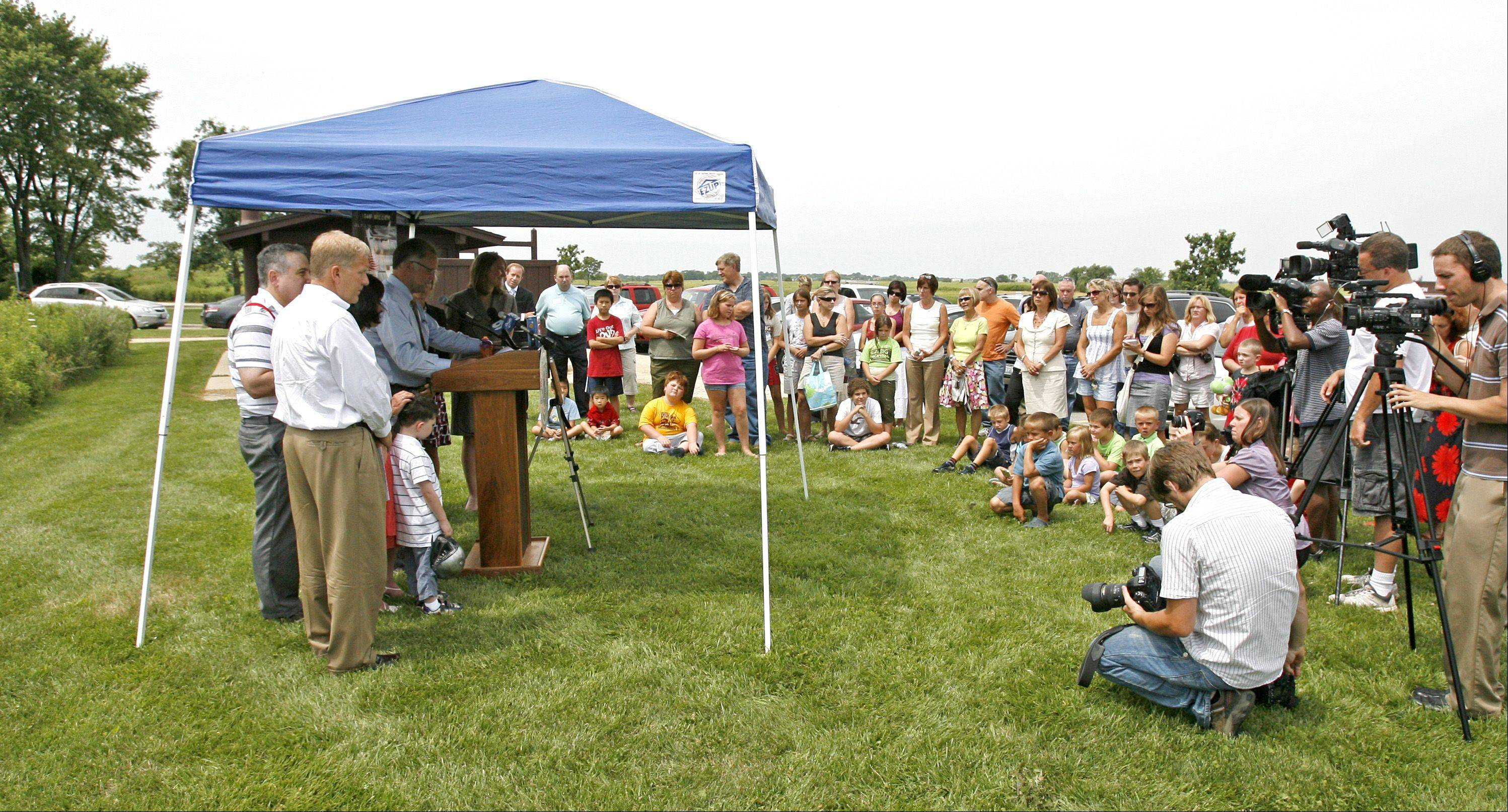 Friends and family gather Friday at Springbrook Prairie Forest Preserve to honor Adam Miller, who died in a 2008 crash involving a distracted driver.
