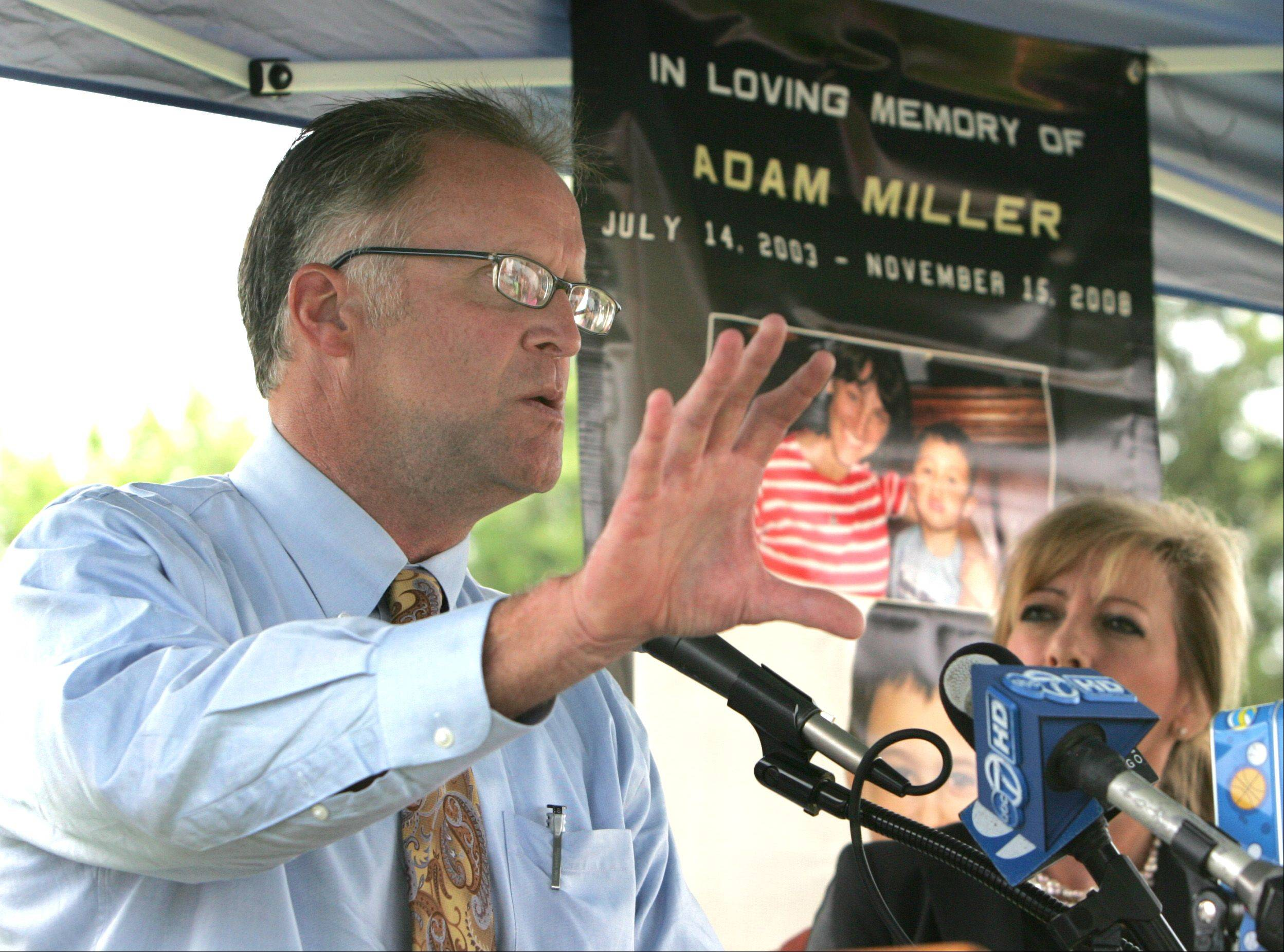 DuPage County Board Chairman Dan Cronin talks Friday about legislation stemming from the 2008 death of John and Cheryl Miller's son Adam, who was killed by a distracted driver.