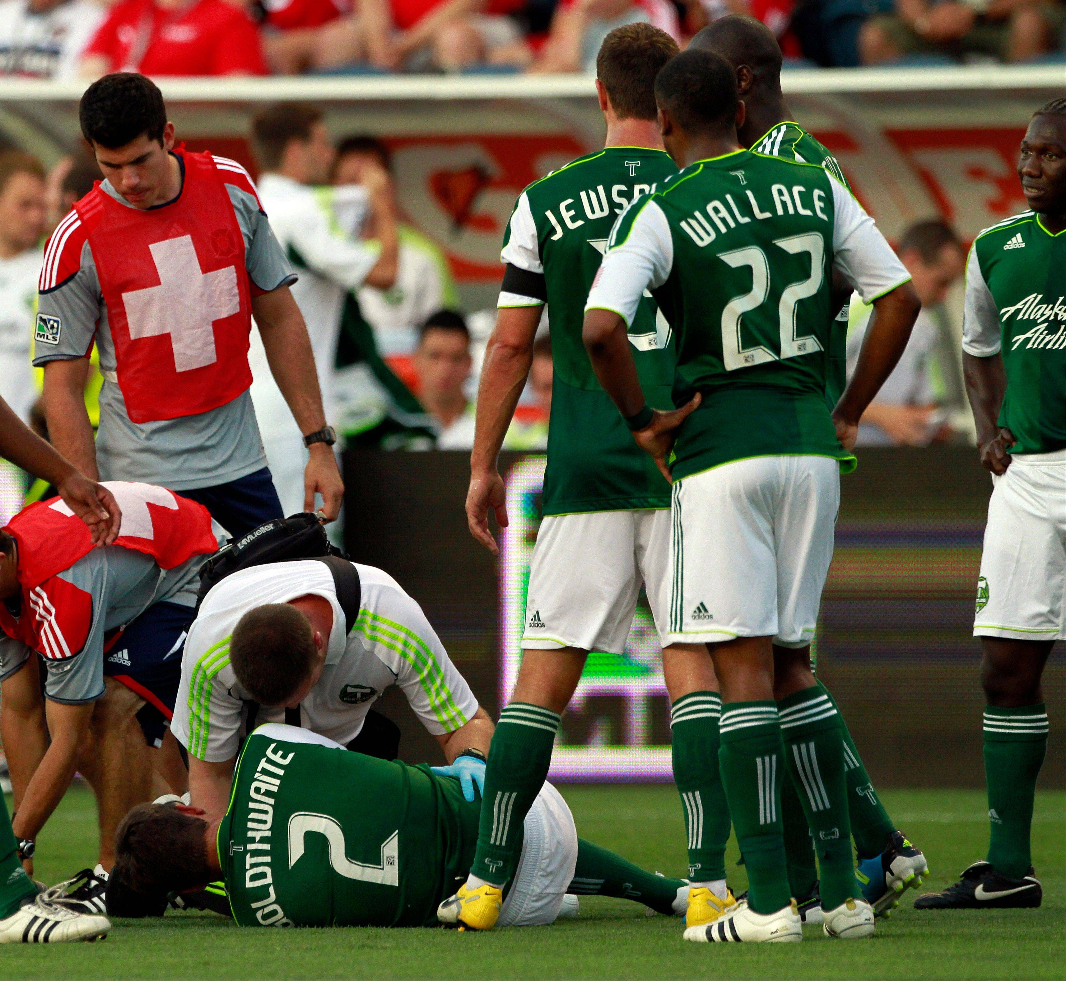 The Portland Timbers' Kevin Goldthwaite is carried off the field after being injured in the first half Saturday at Toyota Park.