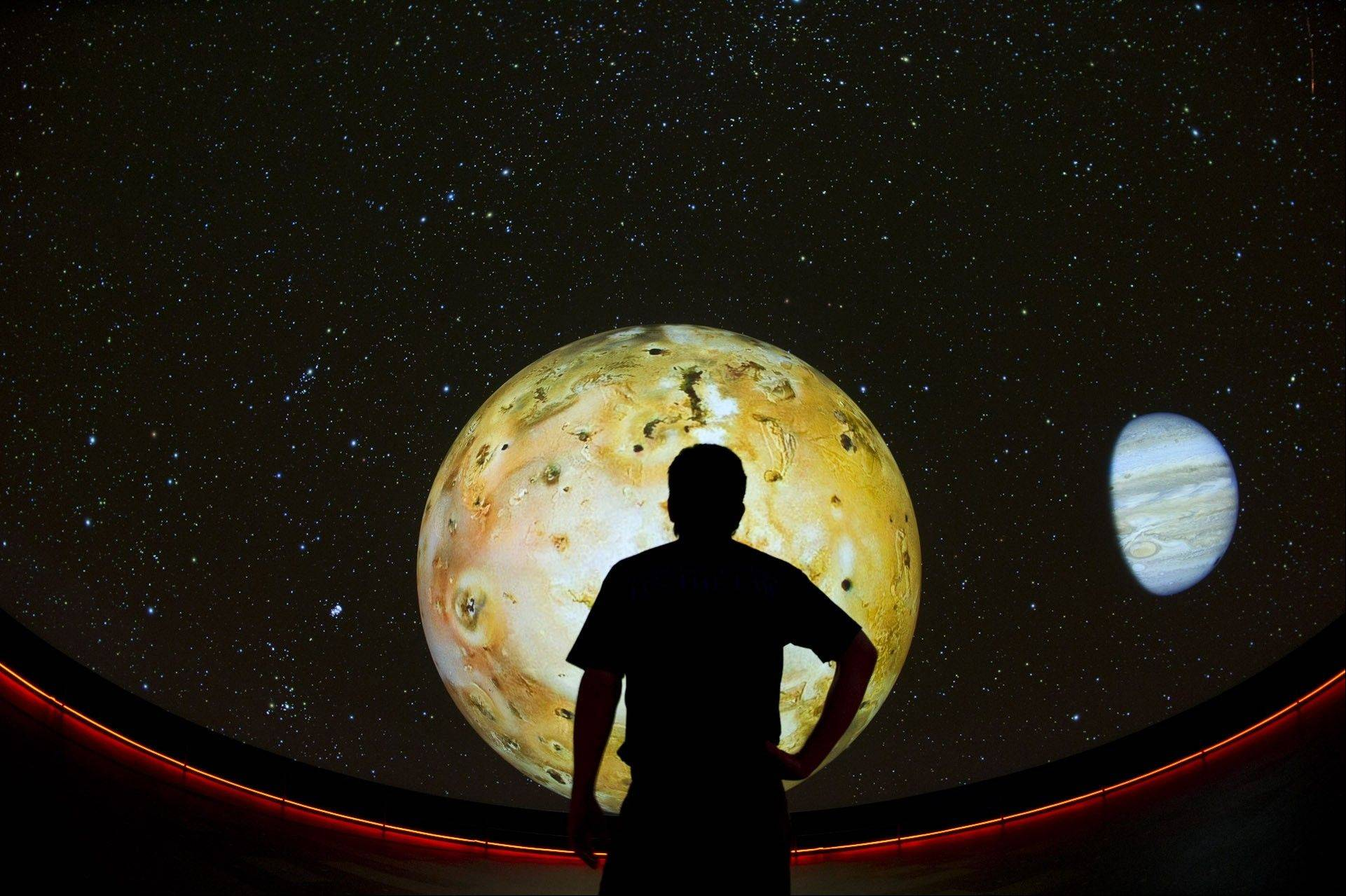 Jupiter's moon Io is projected on the ultra high-definition screen in Adler's Grainger Sky Theater.
