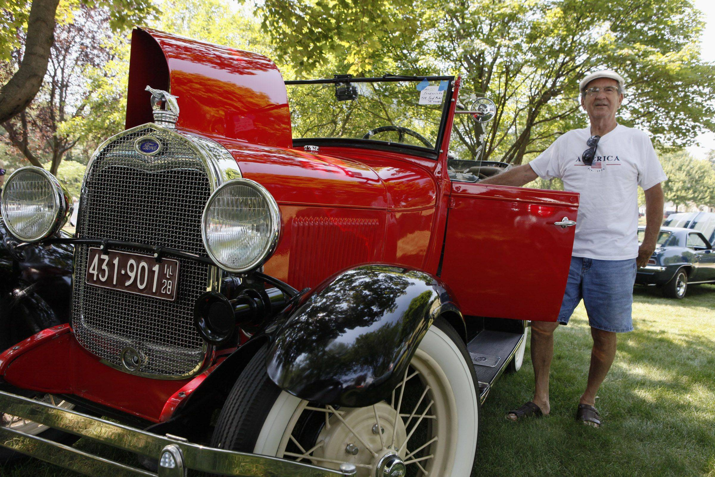 Bernard Fredericks shows off his restored 1928 Ford Model A Roadster during the classic car show Sunday at Itasca Fest.