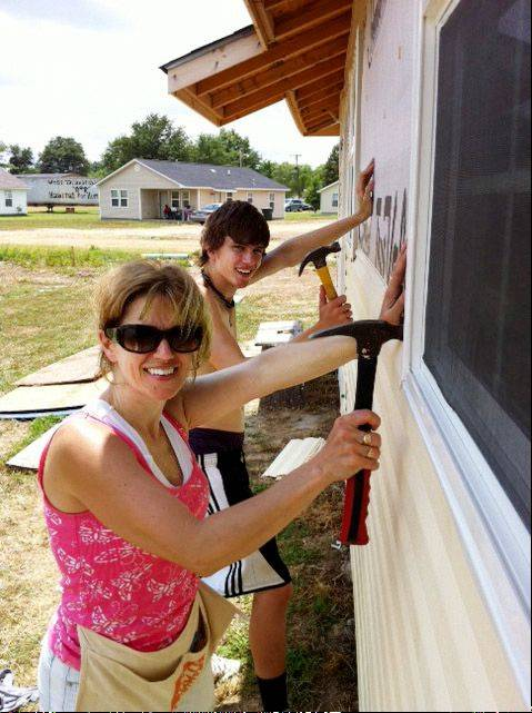 Sugar Grove residents Amy Manion and her son Kevin, 16, were among 26 teens and adults from St. Thomas the Apostle Catholic Church in Naperville who recently traveled to Tutwiler, Miss., to work on two Habitat for Humanity homes there.