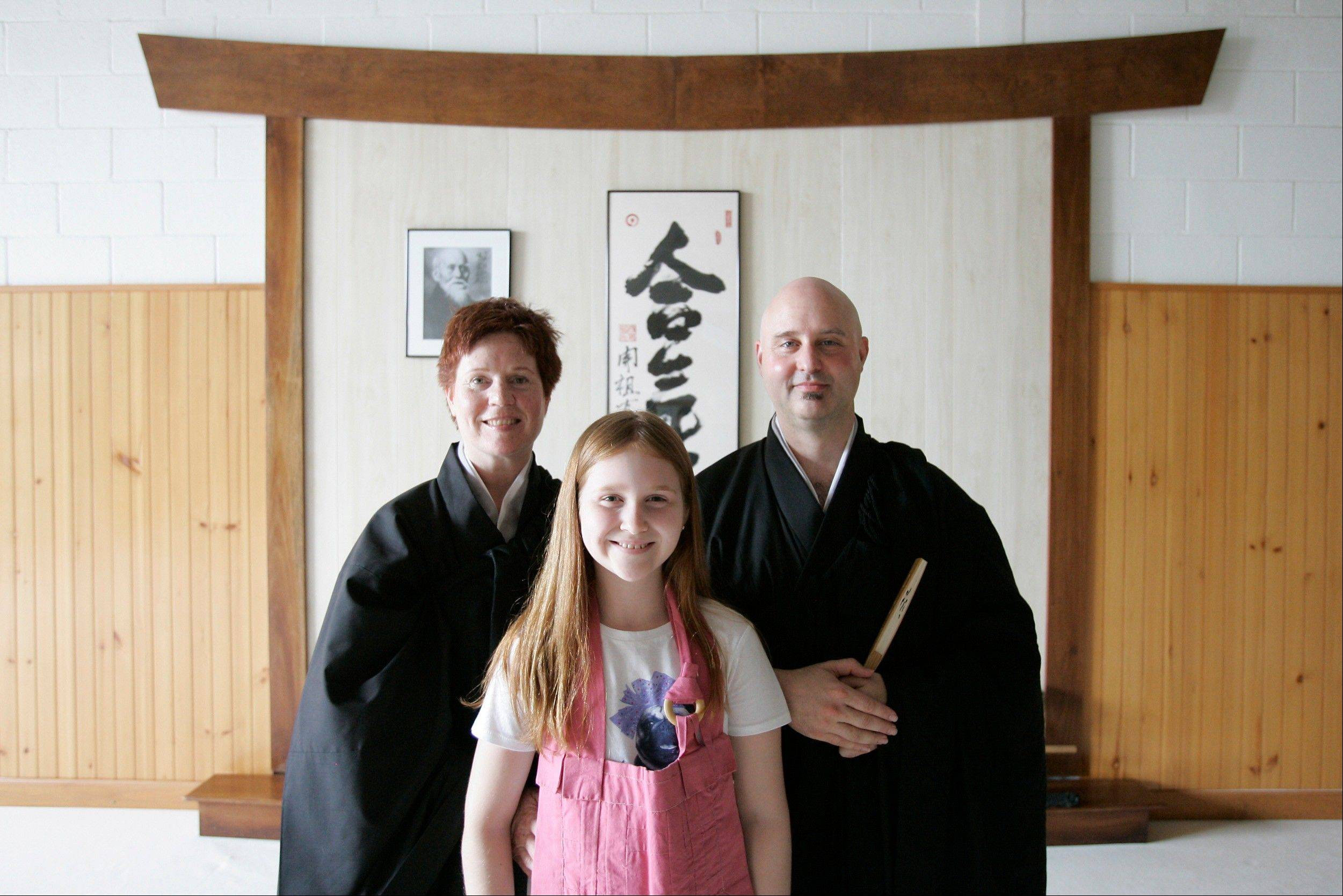 Rev. Karen Do-on Weik and her husband Rev. Jay Rinsen Weik with their daughter, Isabella Weik, 11, at the Toledo Zen Center in Holland, Ohio. Their center has created a Sunday school and other programs to be especially welcoming to families.