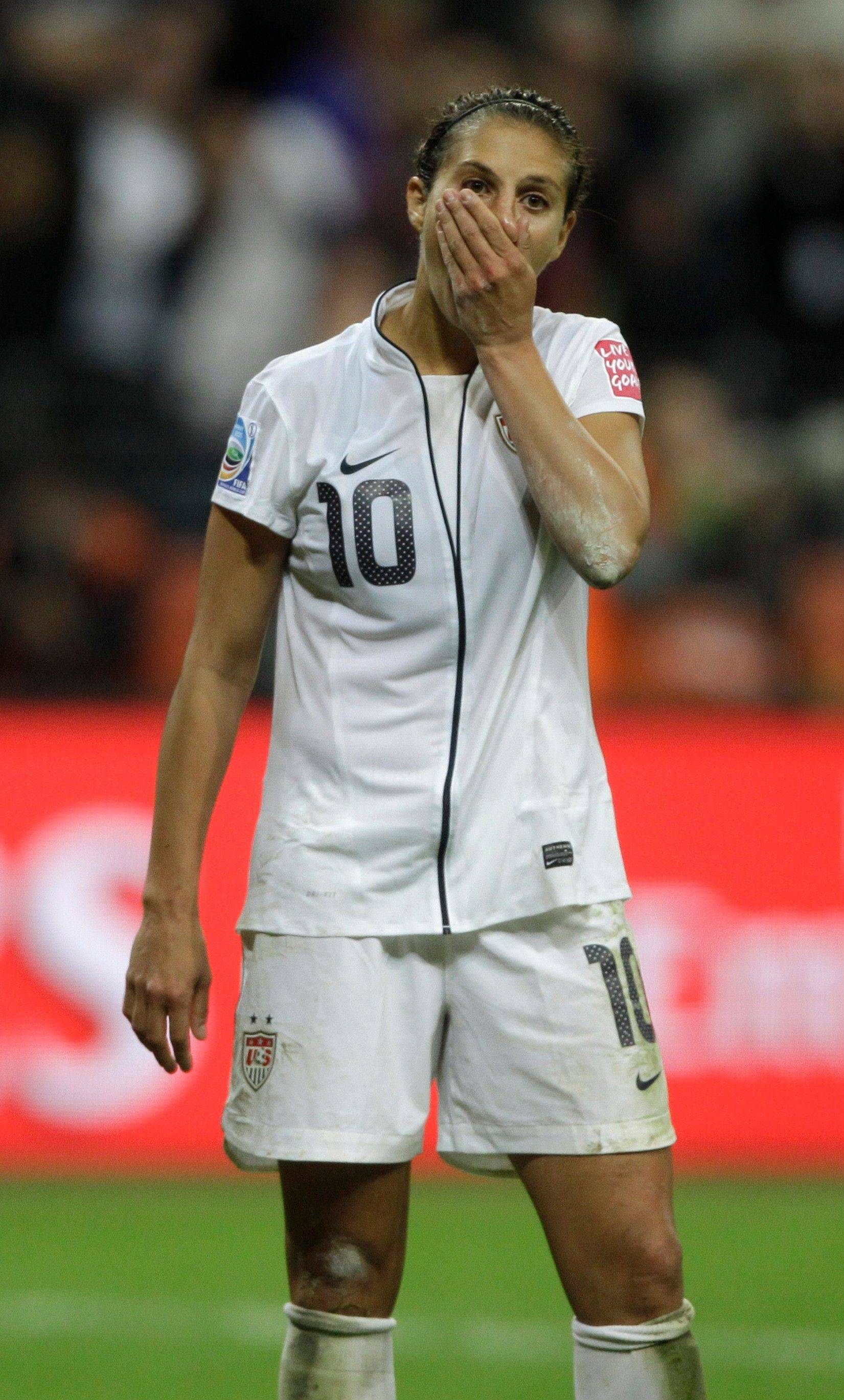 United States soccer playr Carli Lloyd reacts Sunday after missing from the penalty spot during the penalty shoot-out of the final match between Japan and the United States at the Women's World Cup in Frankfurt, Germany.