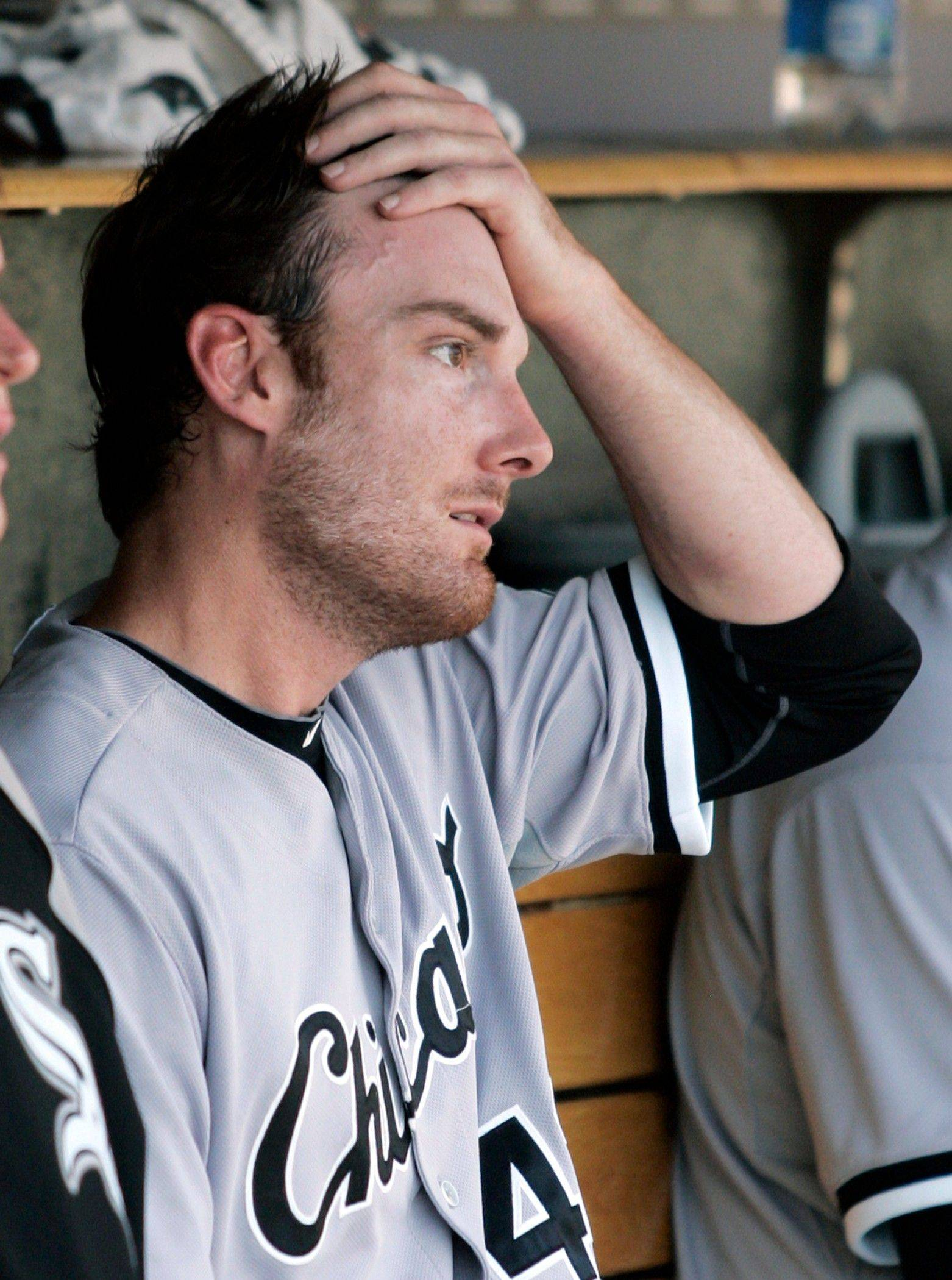 White Sox starting pitcher Phil Humber sits in the dugout after being pulled in the sixth inning against the Detroit Tigers.