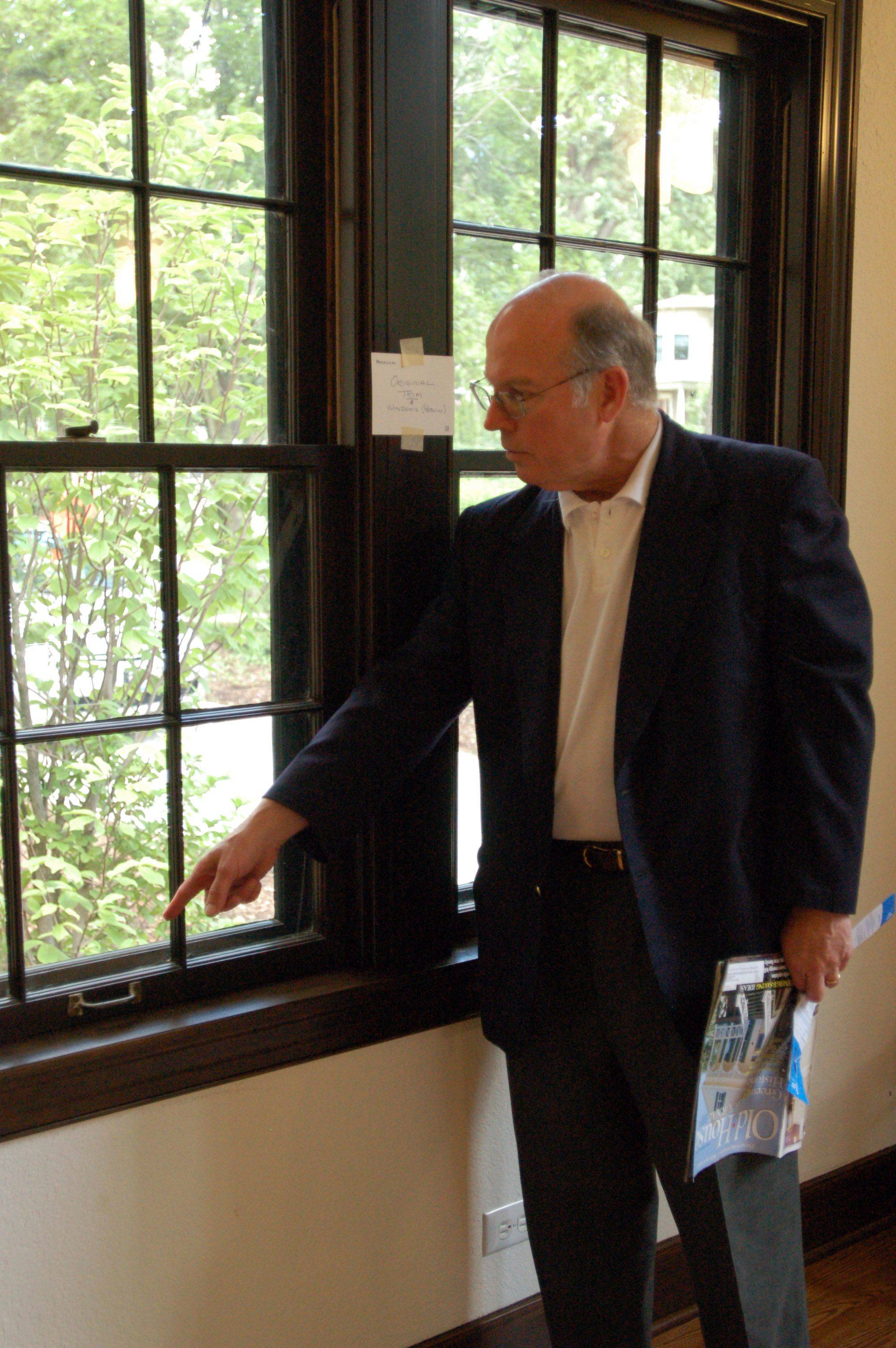 Mahaffey points out the energy-saving materials built around the original window panes in order to seal them.