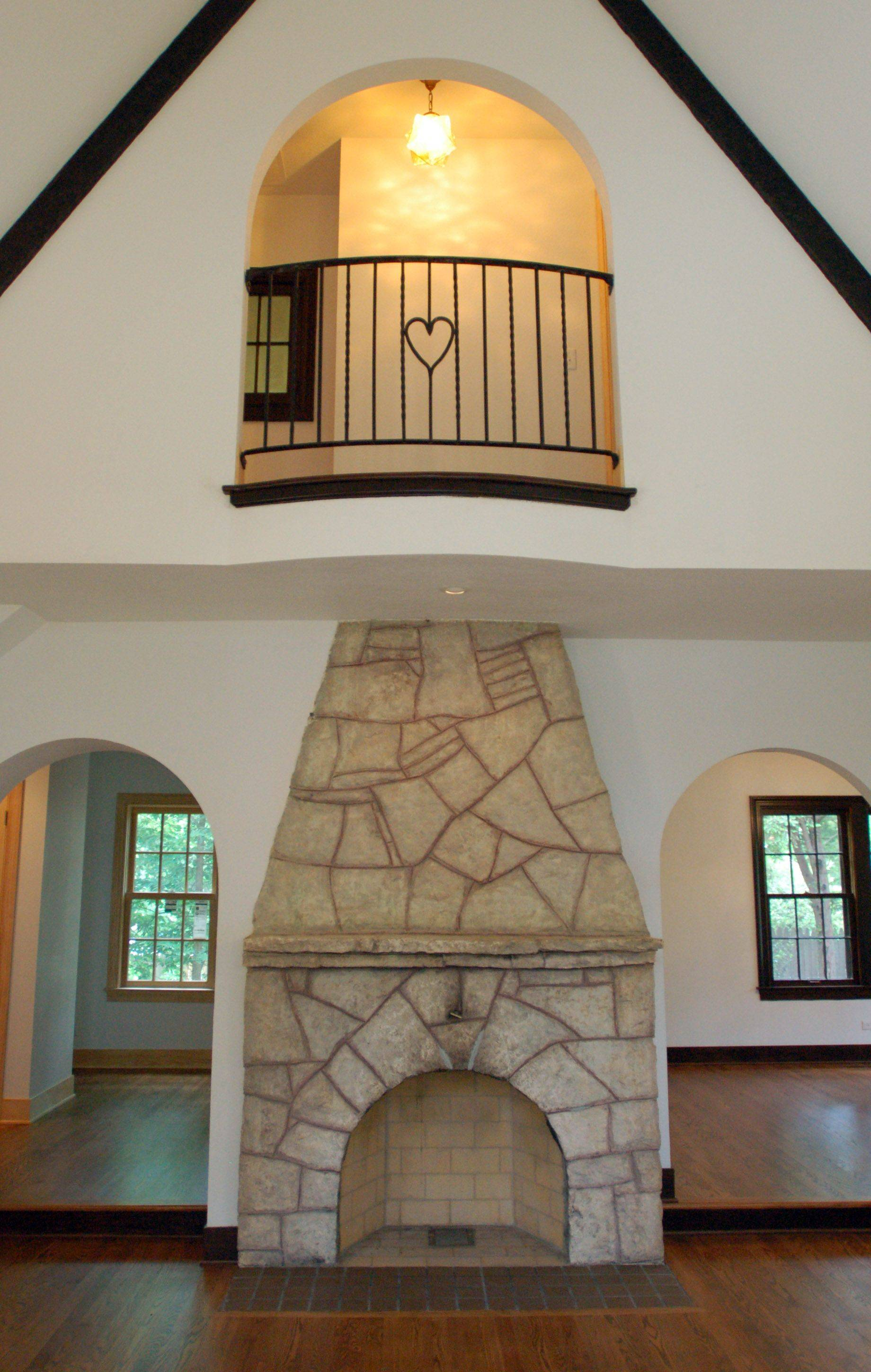 The project's goal was to make the house not only energy efficient, but marketably appealing for a modern-day family. This is the original fireplace.