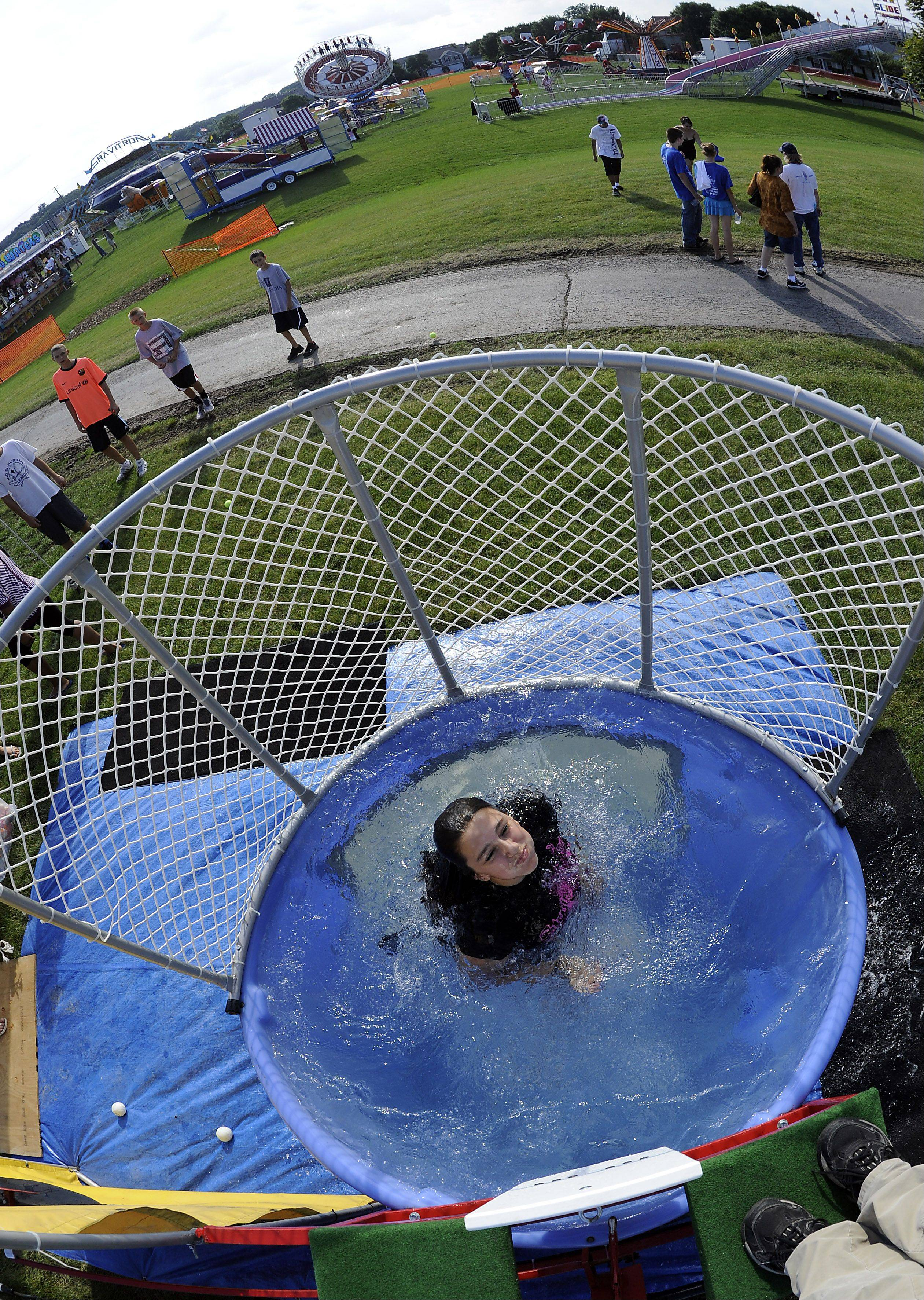 Noey Alagna, 14, of Streamwood mans the dunk tank, which was raising money for the Streamwood High School cheerleaders at the Streamwood Summer Celebration on Friday.