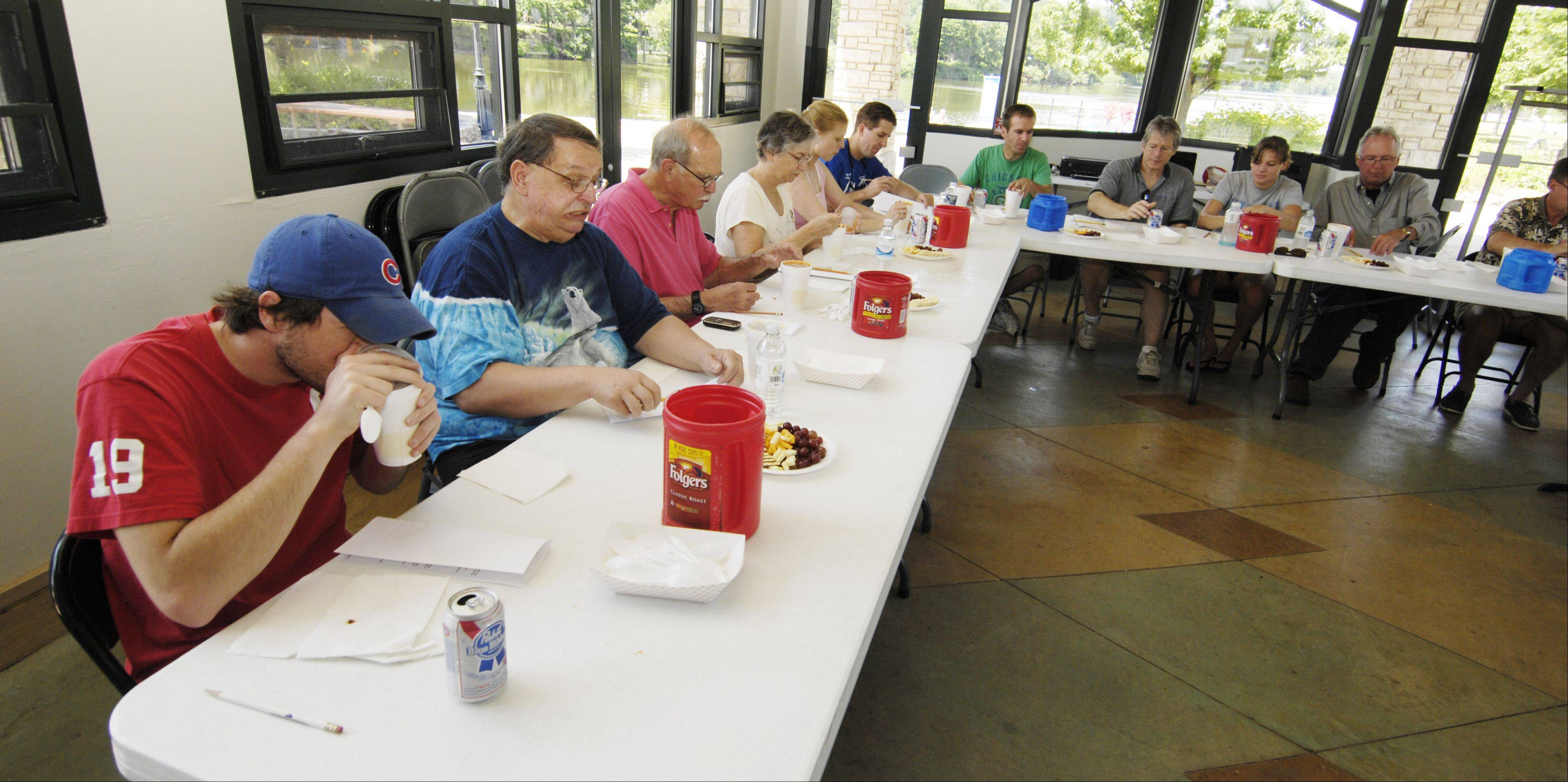 A panel of judges sample chili during the Windmill City Chili Cookoff in Batavia.