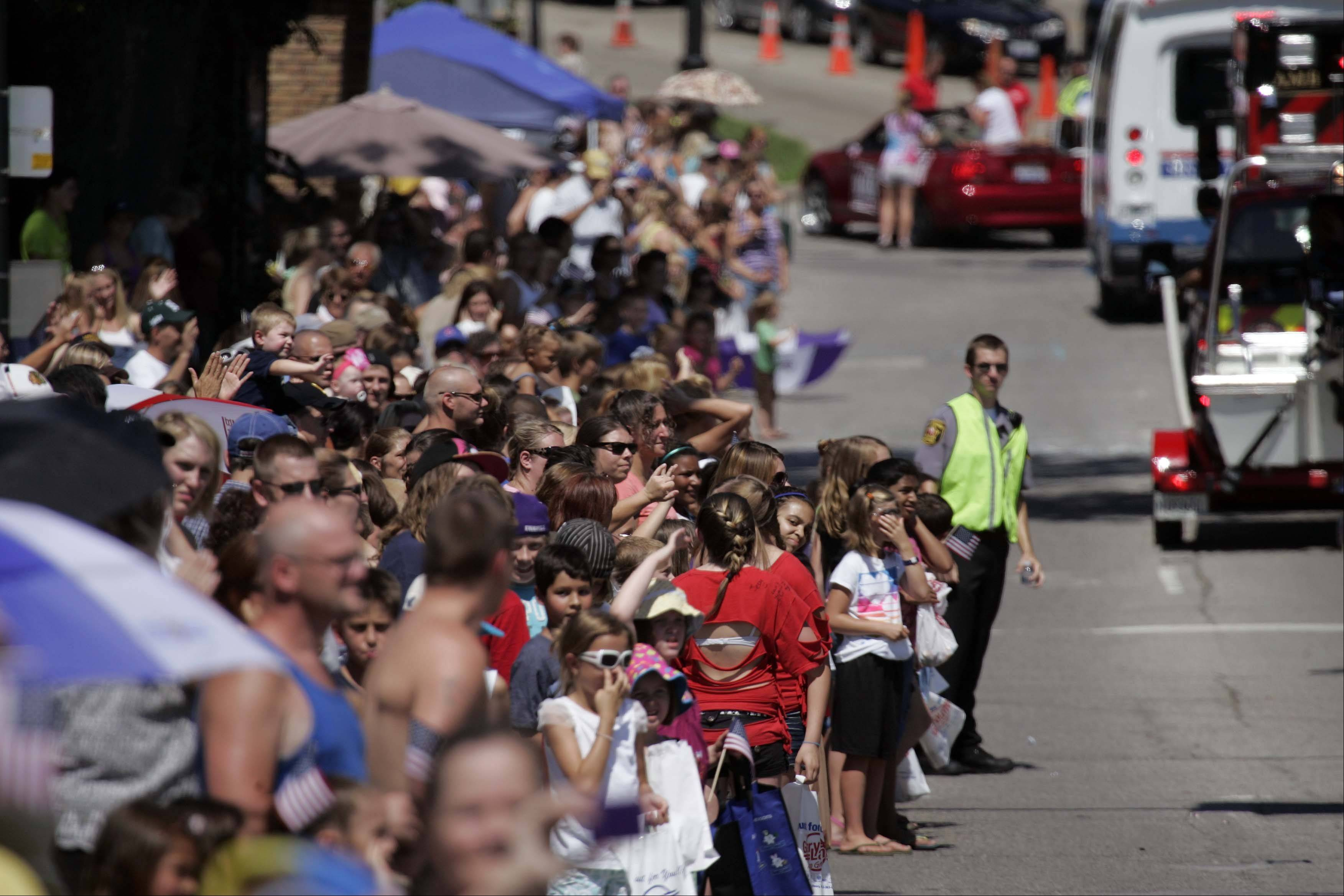 Thousands of people line the streets to see the Under the Sea Parade at the Annual Founders' Days Festival in Algonquin Saturday, July 30, 2011.