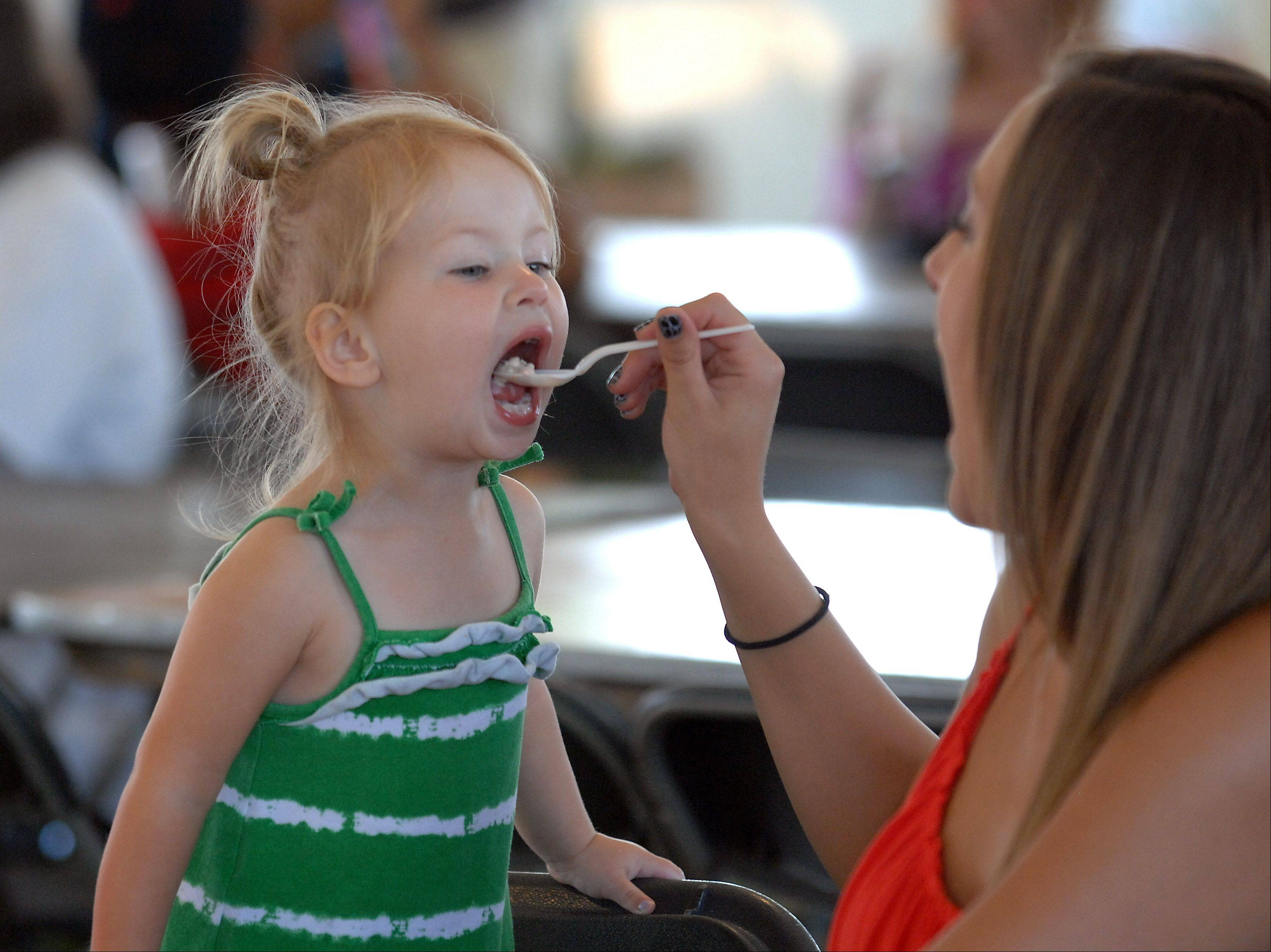 Layla Marcus, 2, of Elgin enjoys some Dippin Dots at the Streamwood Summer Celebration on Friday.