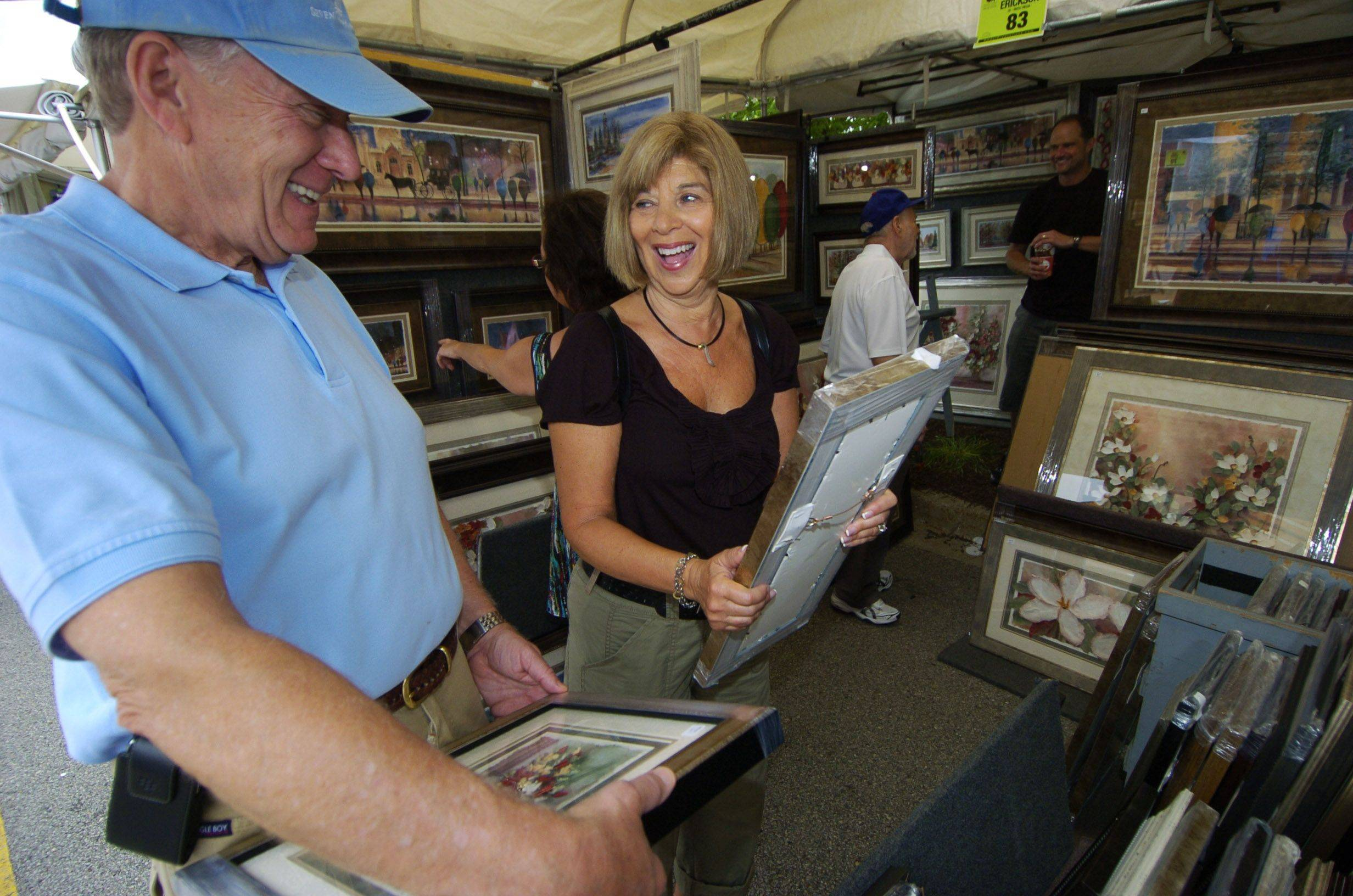 Herb and Bonnie Horn of Glenview view prints during the Buffalo Grove Invitational Arts Festival Saturday.