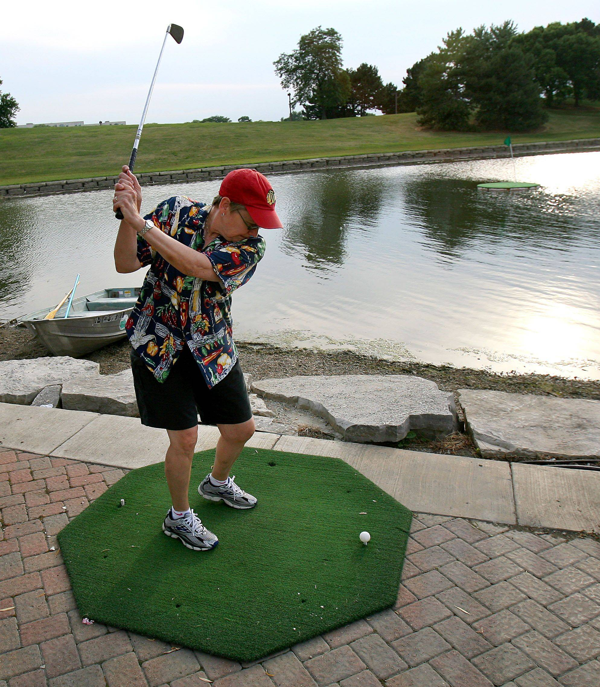 Paula Lipson of Vernon Hills tries her hand at a hole-in-one challenge Friday night at Vernon Hills' Summer Celebration at Century Park