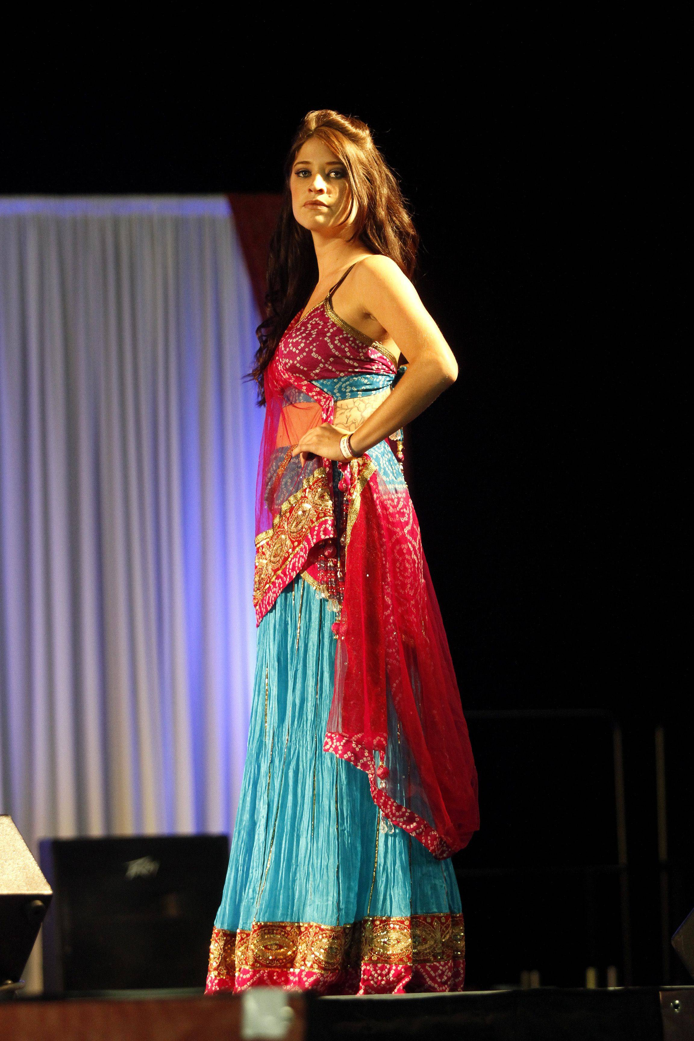 A model shows off a traditional Indian outfit during a fashion show at the Vibrant India Festival held at the Sears Center Sunday afternoon. The fest also featured music, food, and clothing and jewelry vendors.