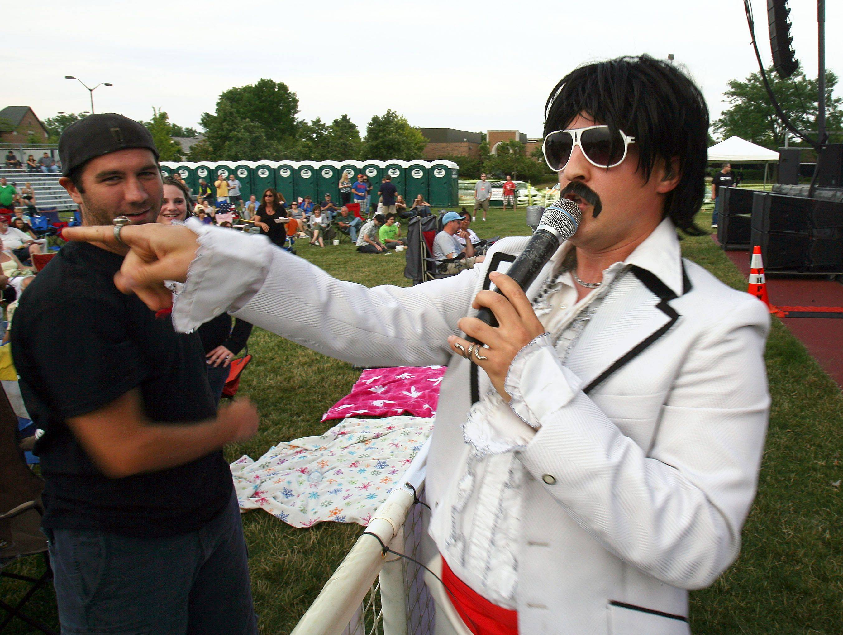 "Mayor Manaconda of ""Wedding Banned"" enters the crowd during a performance Friday night at Vernon Hills' Summer Celebration."