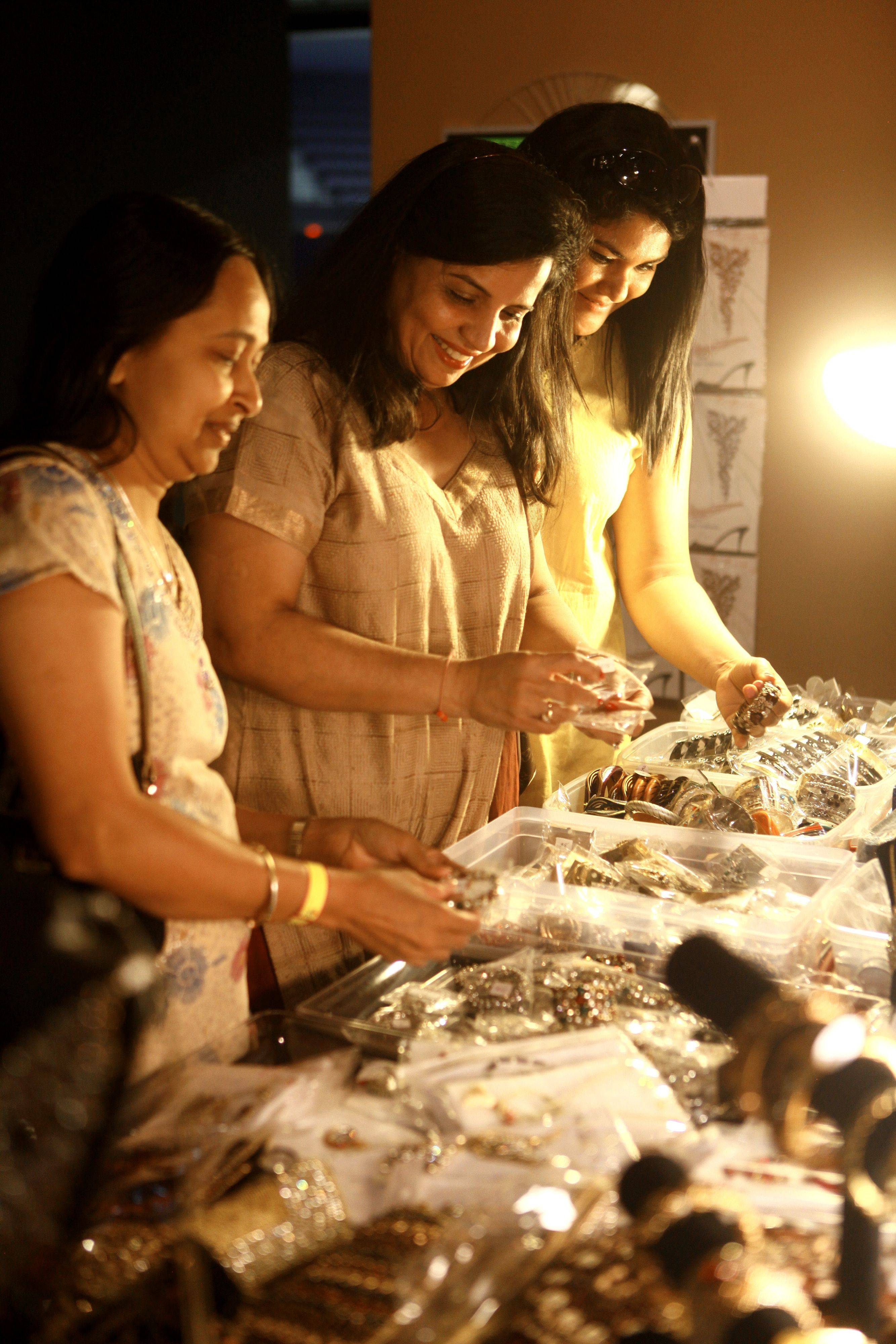 From Left, Sujata Shah, from Crystal Lake, Minal Shah, from Vernon Hills, and Dipali Shah, from Naperville, browse the selection of jewelry on display at the Sears center for the Vibrant India Festival Sunday afternoon. The fest featured music, food, clothing and jewelry vendors.