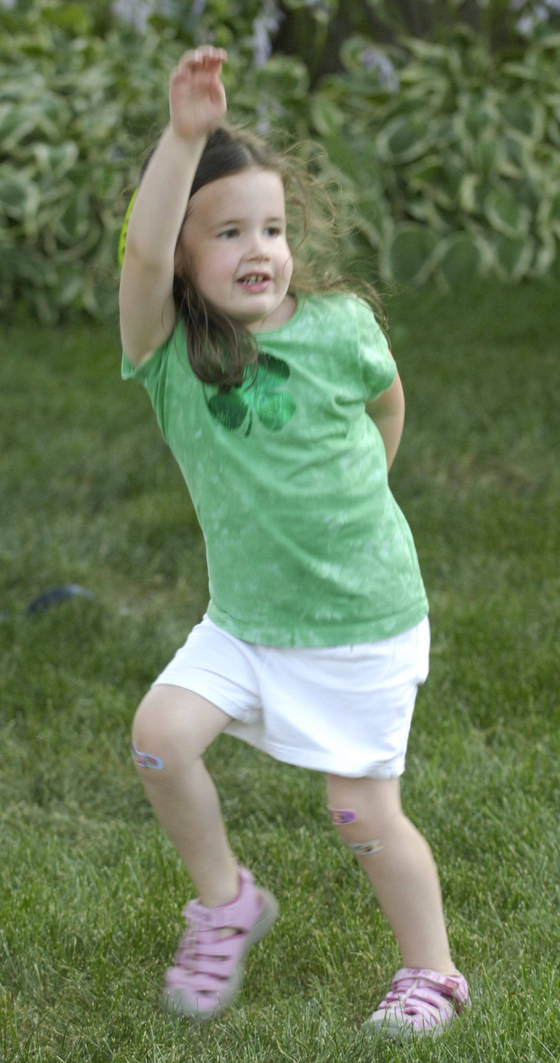 Maggie Troup, 4, of Arlington Heights dances to the music during Irish Fest in Arlington Heights Friday.