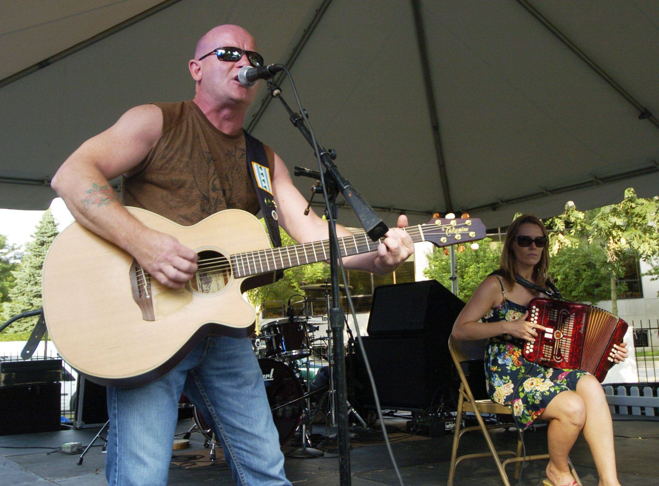 Barry Fagan of Finbarr Fagan sings and plays guitar while Sheila Doorley plays the accordion during Irish Fest in Arlington Heights Friday.