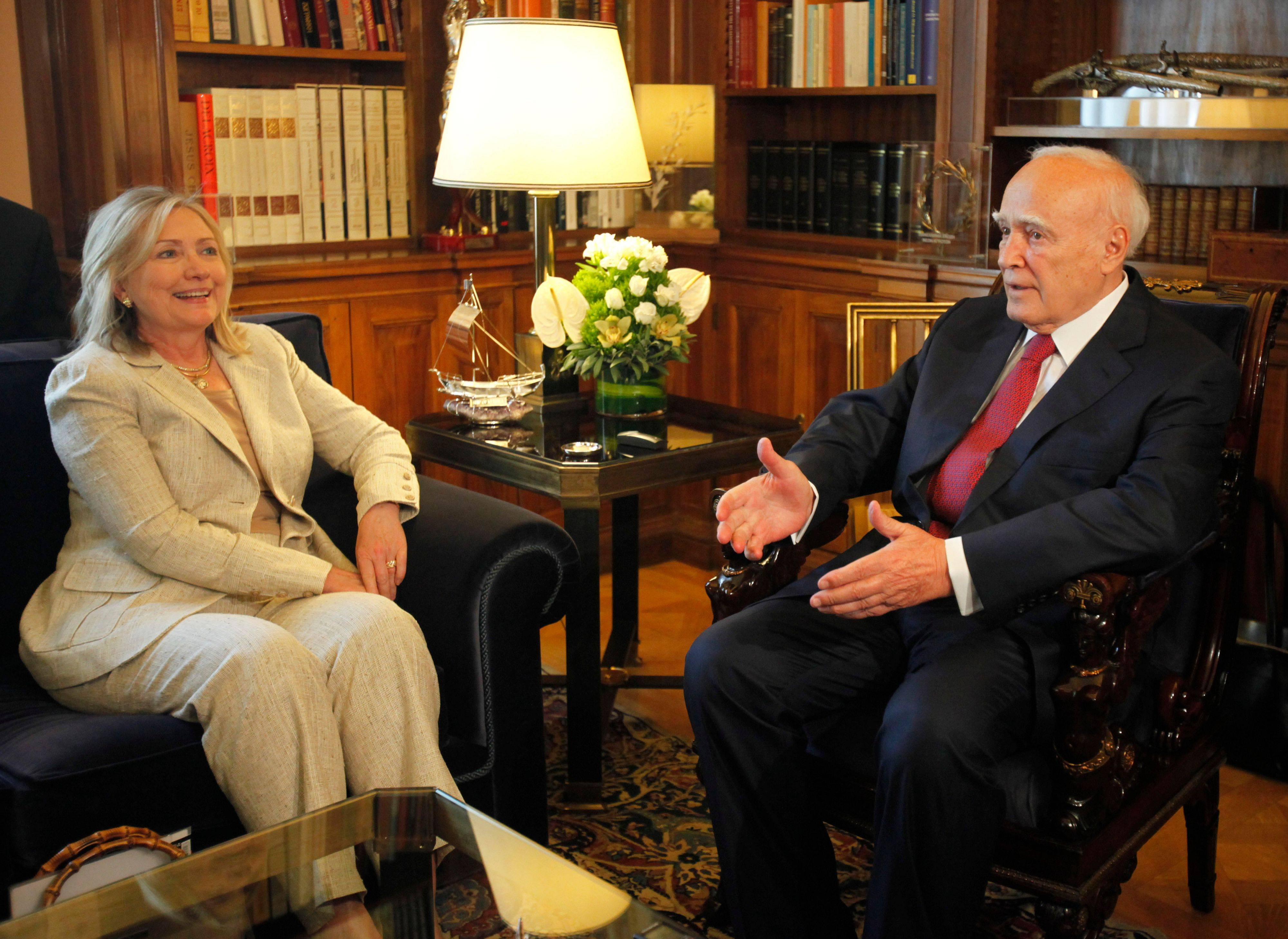 Secretary of State Hillary Rodham Clinton, left, talks with the Greek president Karolos Papoulias at the Presidential Palace in Athens on Sunday.