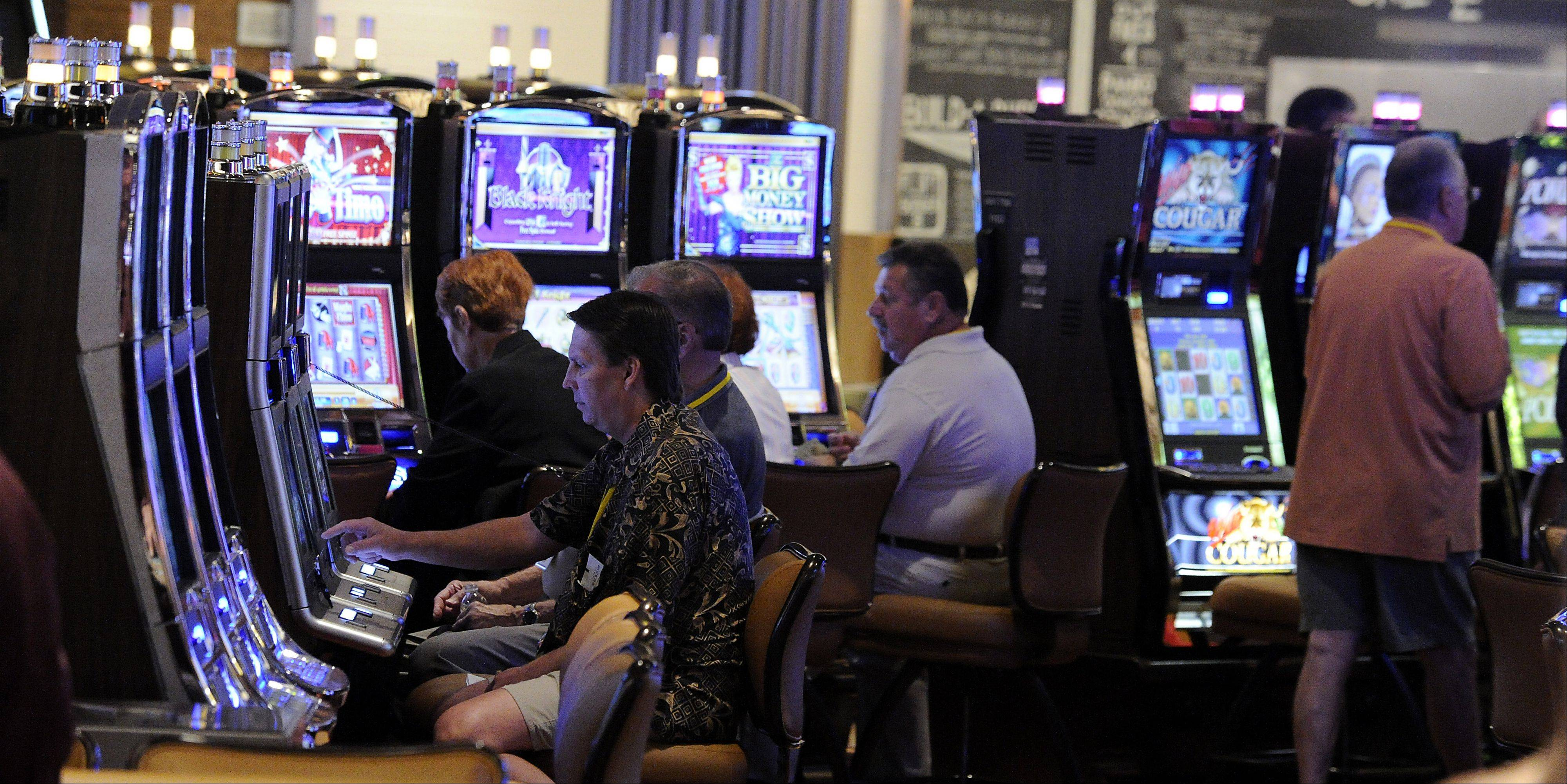 Bells of the slots fill the air to signal the opening of the Rivers Casino in Des Plaines to over 1,000 VIPs on Friday night.