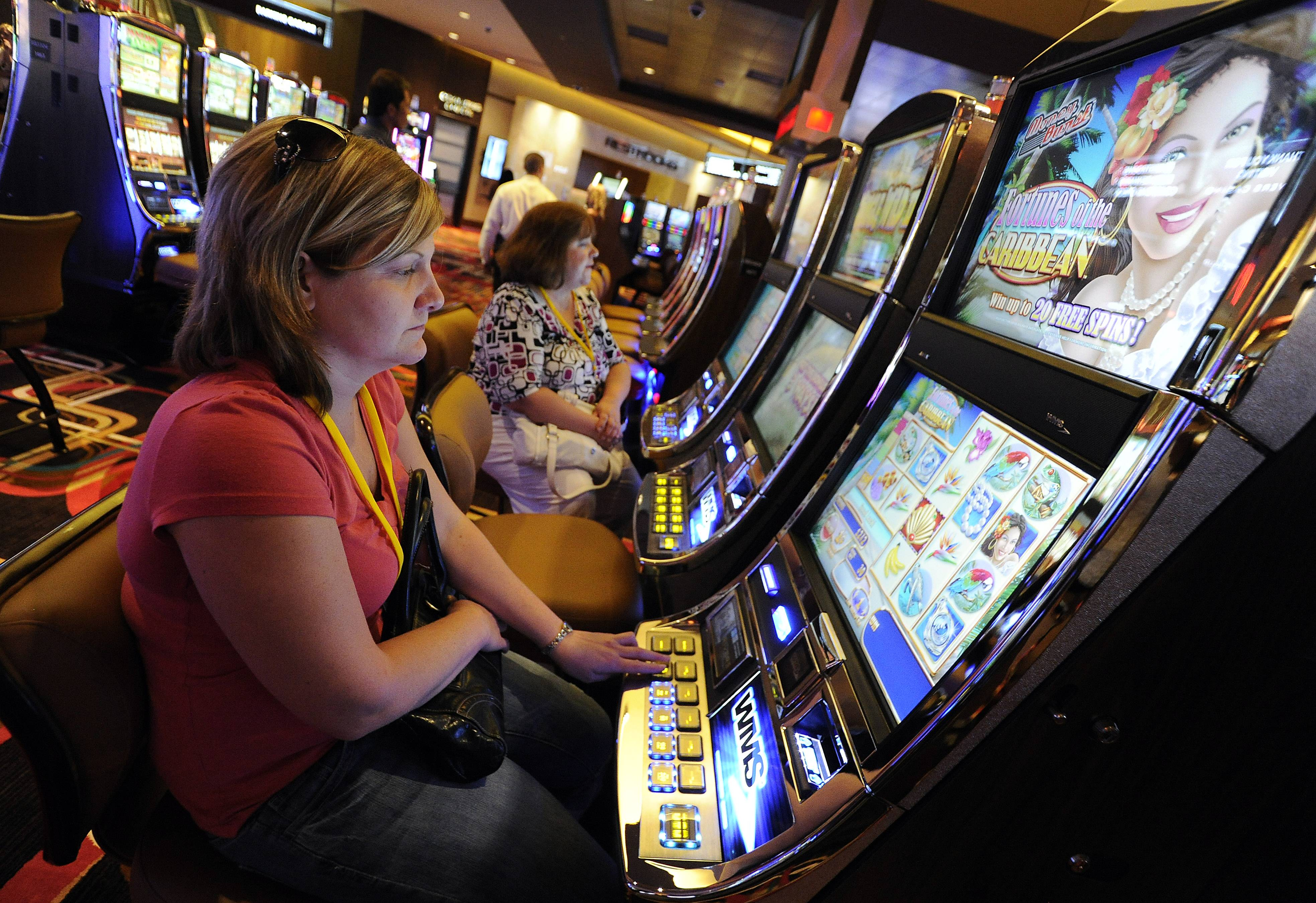 Jennifer Coriell of Burbank plays the penny slots at the VIP party Friday night.