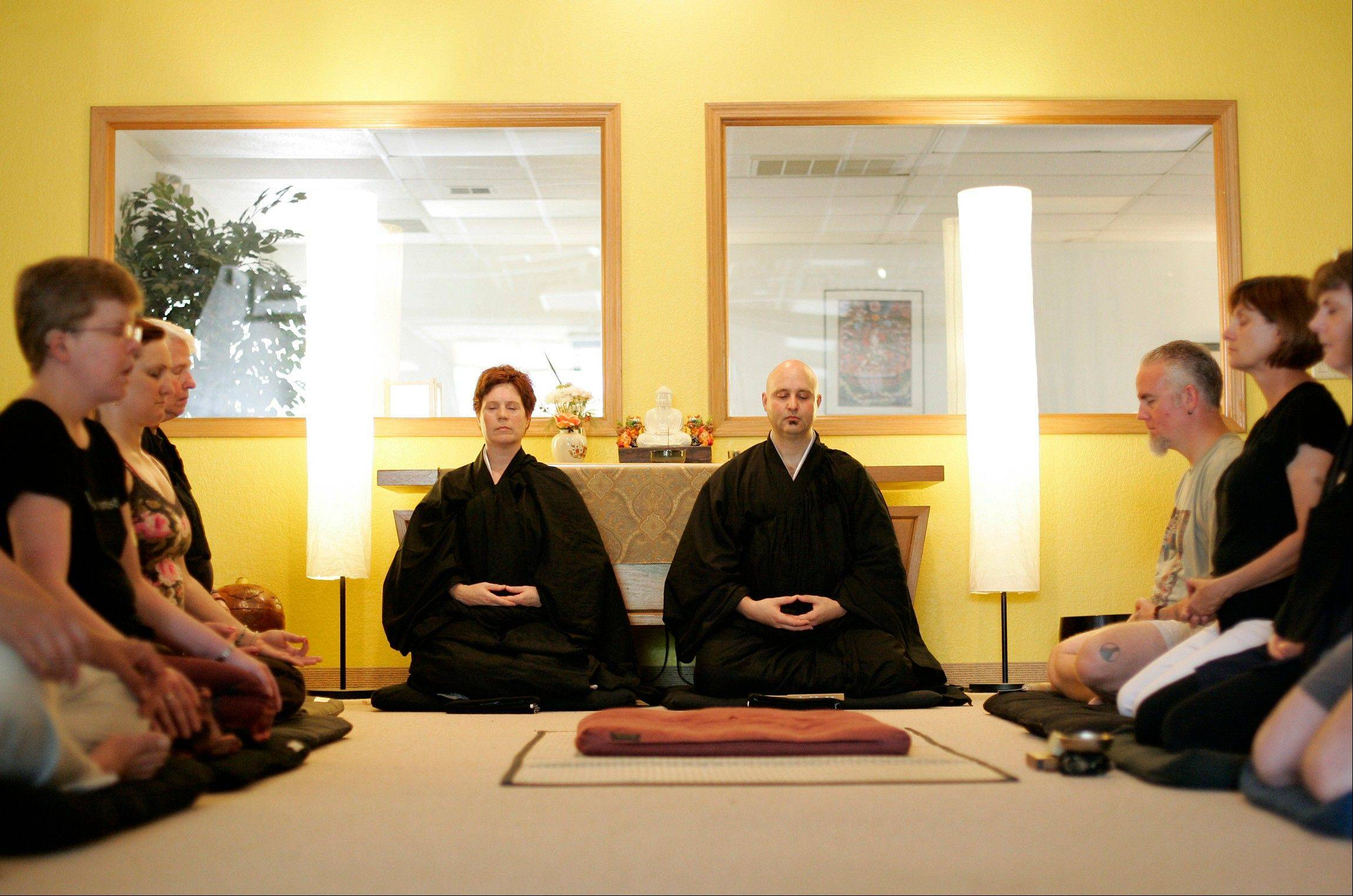 Rev. Karen Do-on Weik and her husband Rev. Jay Rinsen Weik meditate at the Toledo Zen Center in Holland, Ohio. The two have created a Sunday school and other programs to be especially welcoming to families.