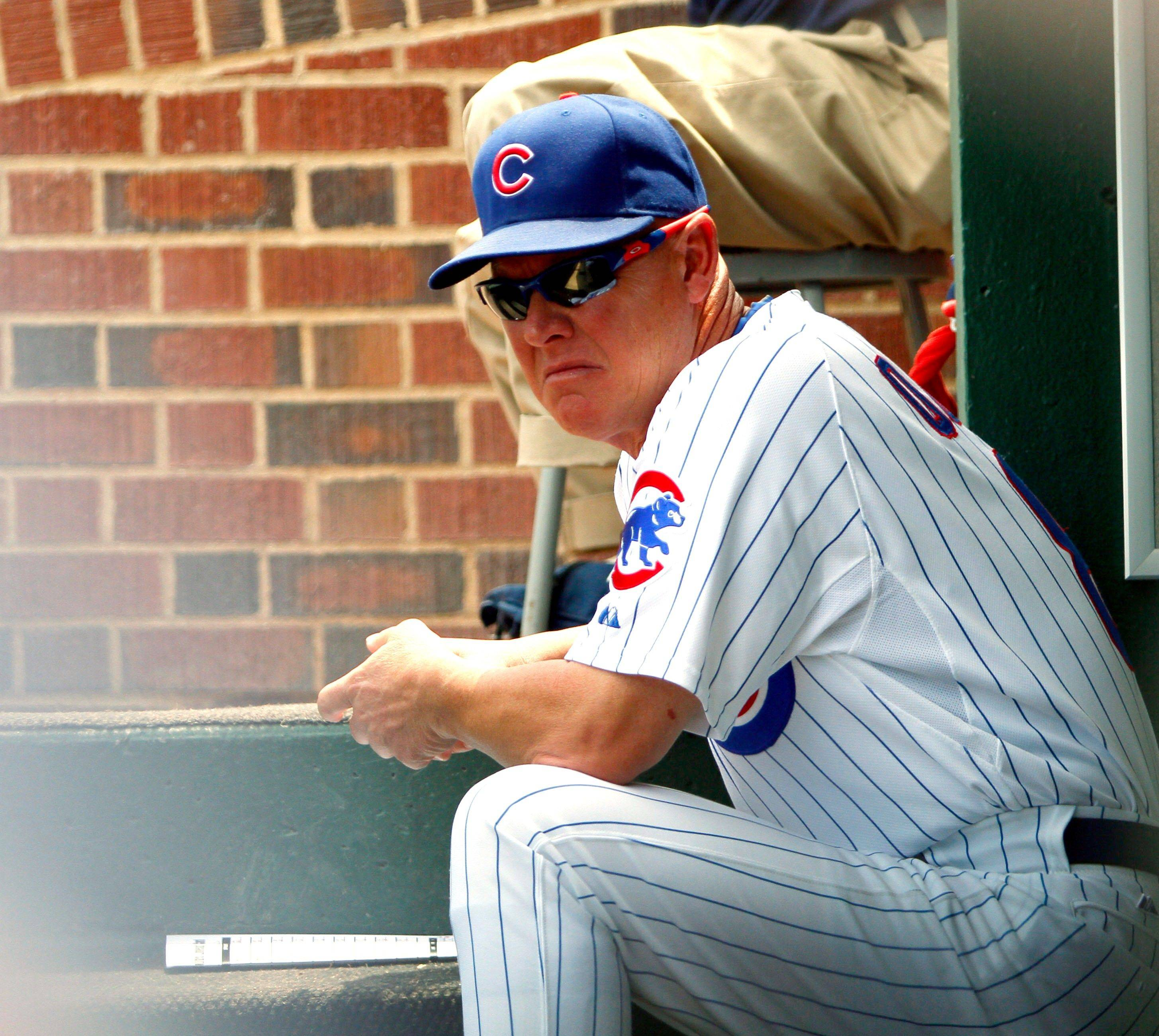 Cubs manager Mike Quade sits in the dugout after the final out, his team falling to a 38-58 with Sunday's loss to the Florida Marlins.