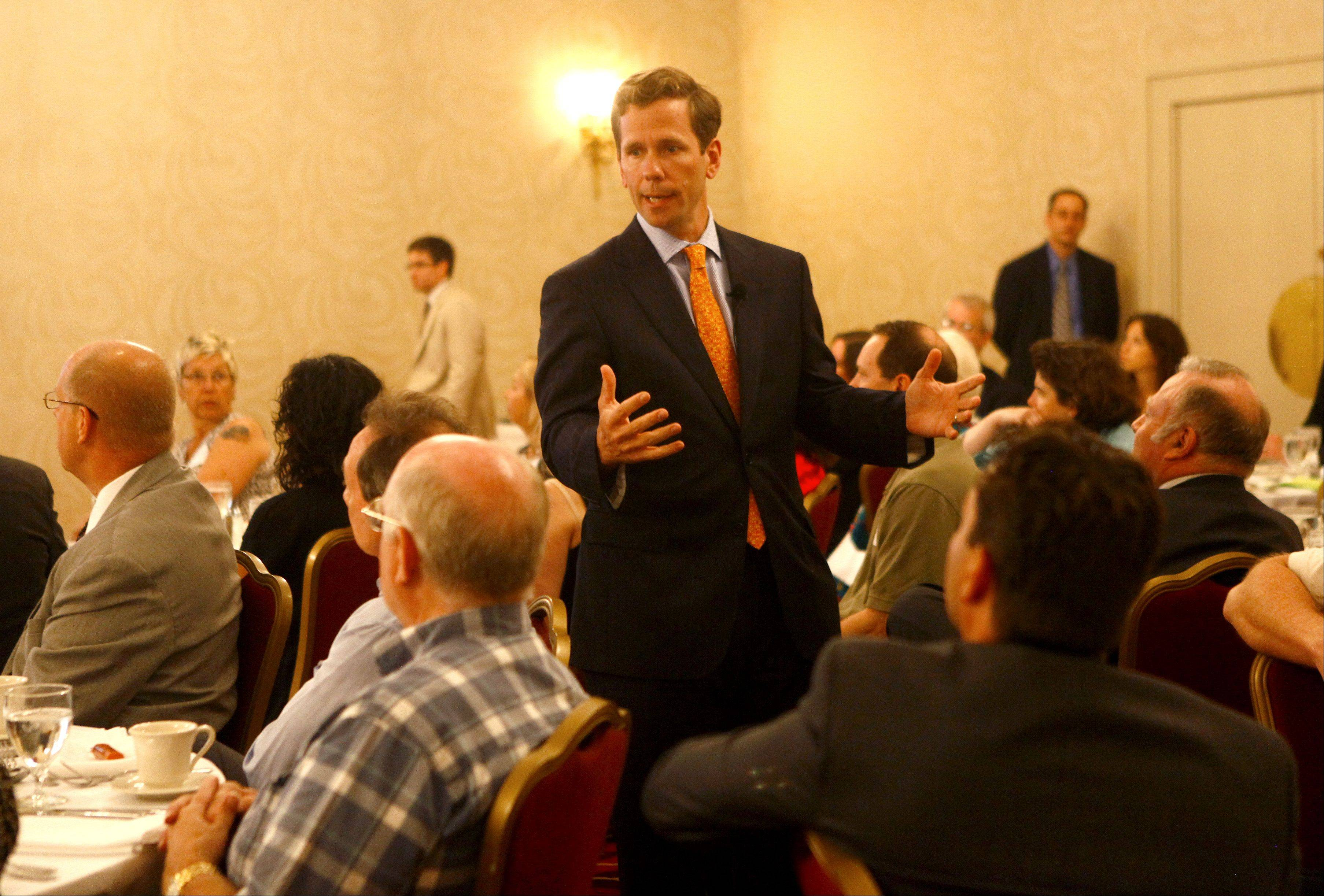 U.S. Rep. Robert Dold addresses the audience at the Multi-Chamber Legislative Lunch in Northbrook Monday.