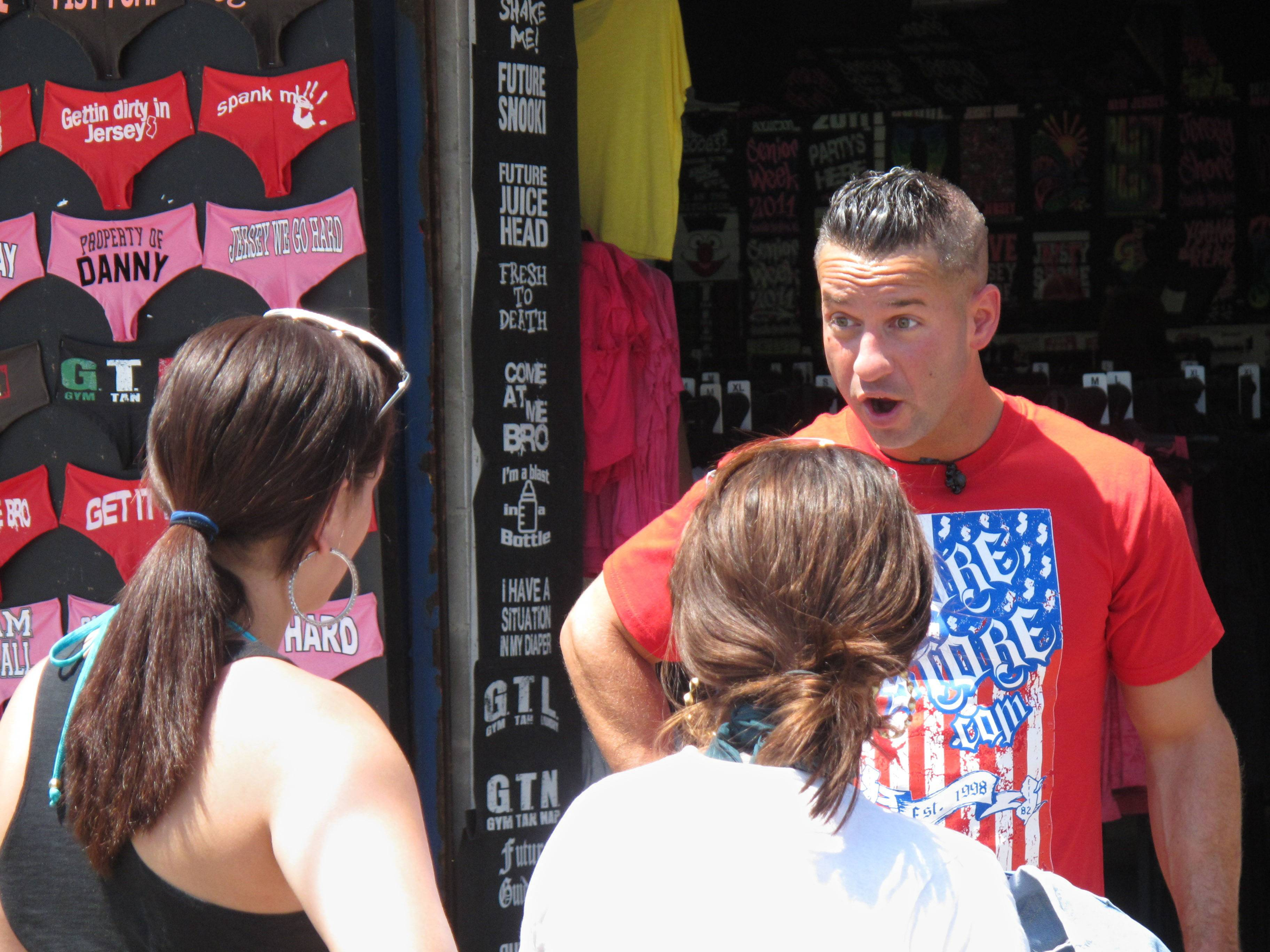 "Michael ""The Situation"" Sorrentino talks to Michelle Diaz, left, and Patricia Garcia, both of Philadelphia, on the boardwalk in Seaside Heights, N.J., during a break while taping an episode of the MTV series ""Jersey Shore"" on Friday."