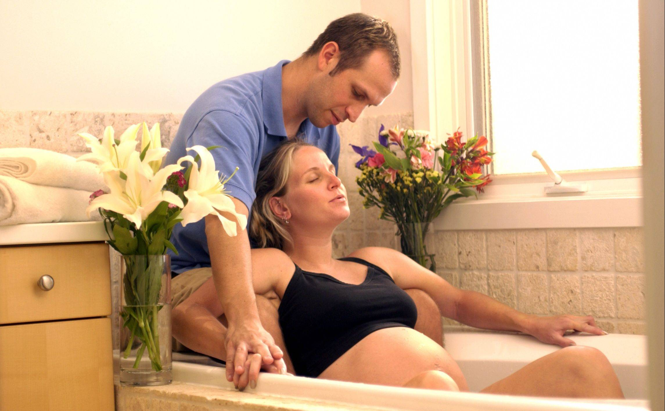 Water births in bathtubs have become a popular delivery option at home.