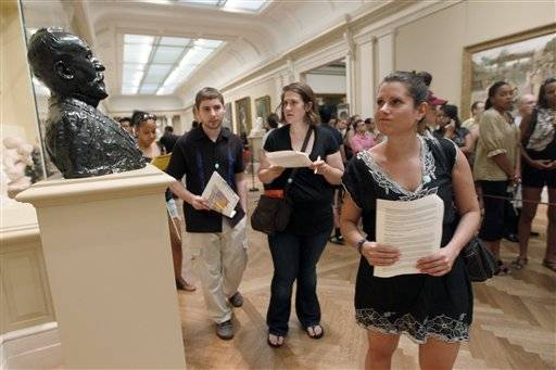 "Matthew Meche, left, Dana Zolli, center and Noga Pnueli look for clues in one of the galleries at the Metropolitan Museum of Art during a Watson Adventures ""Murder at the Met"" scavenger hunt, in New York."