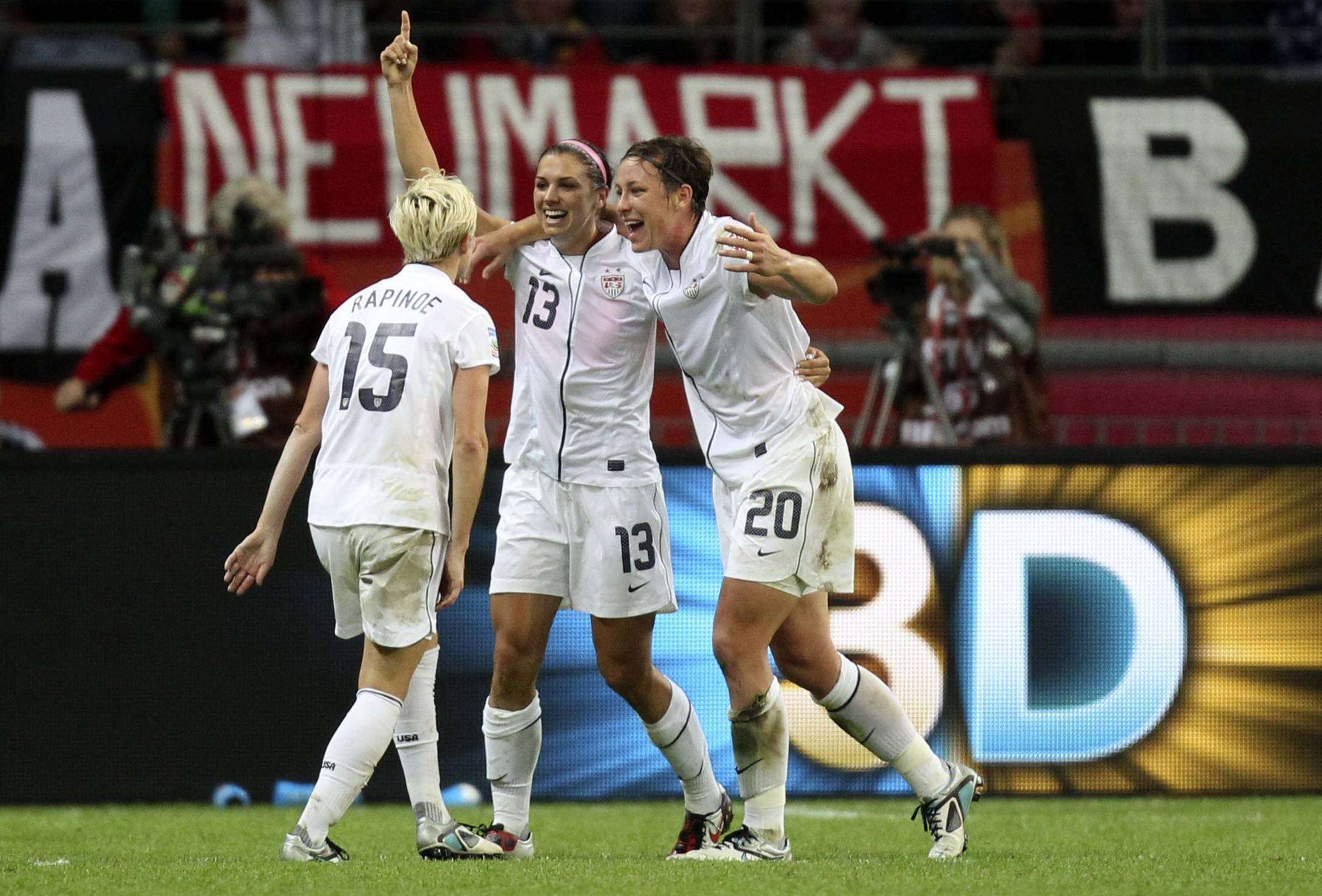 Alex Morgan, center, celebrates with Abby Wambach and Megan Rapinoe, left, after scoring the opening goal during World Cup final Sunday.