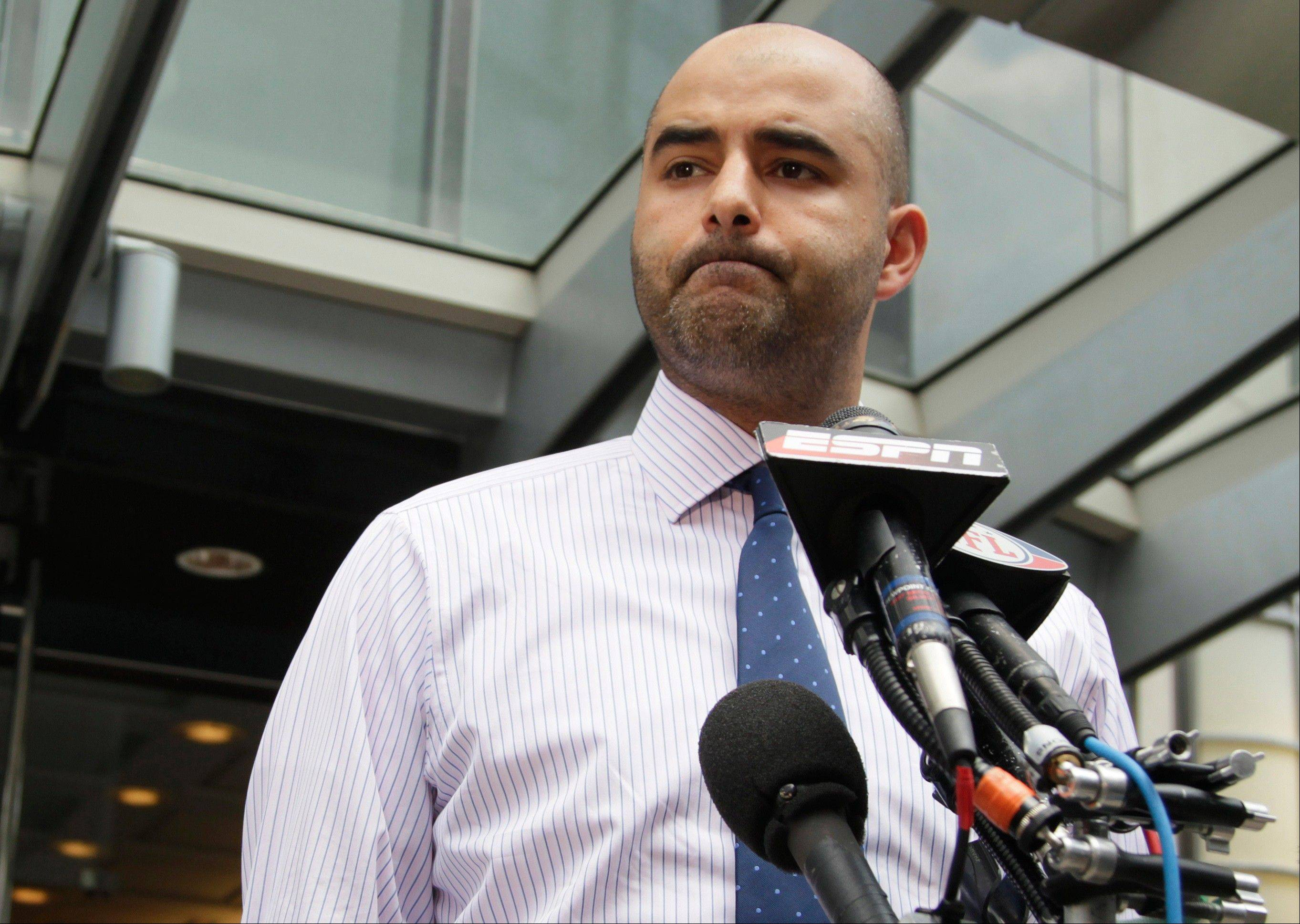 NFL Players Association spokesman George Atallah pauses as he speaks to media in Washington on Monday.