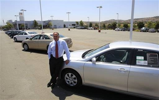 Wayne B. Meyer, President of Sunroad Automotive in San Diego, leans on a car at his Chula Vista, Calif. dealership where a diminished inventory for small cars is evident in his near empty lot.