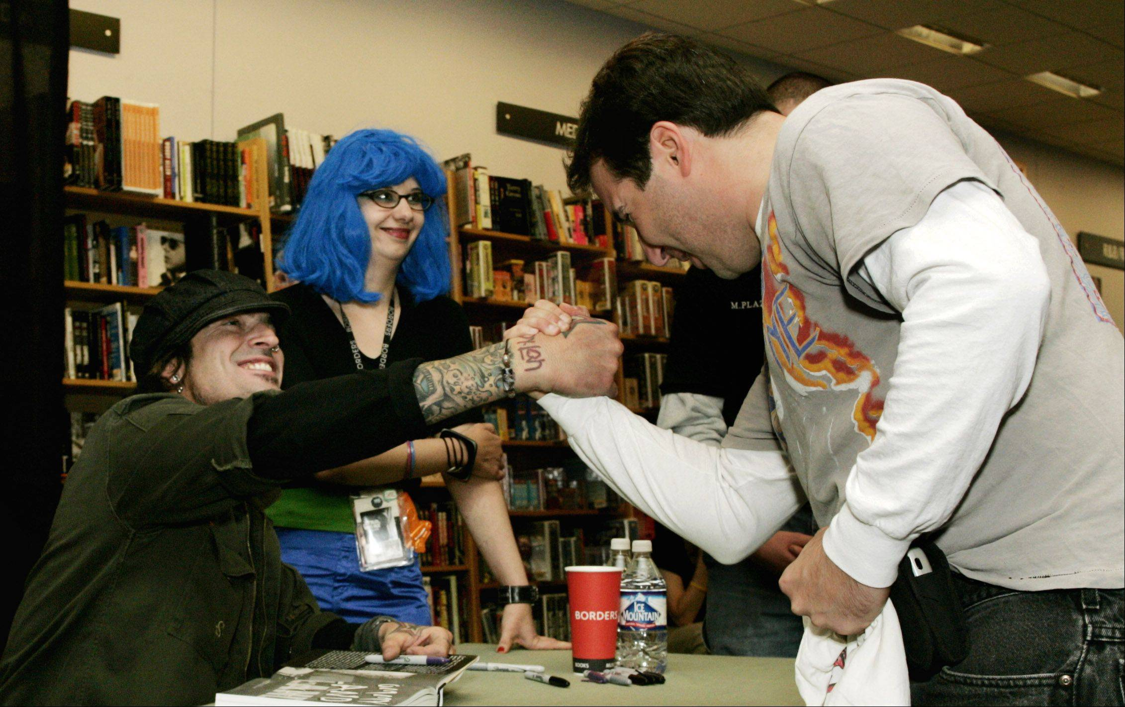 Motley Crue rocker Tommy Lee signed books in 2004 at the Borders store in Oak Brook.