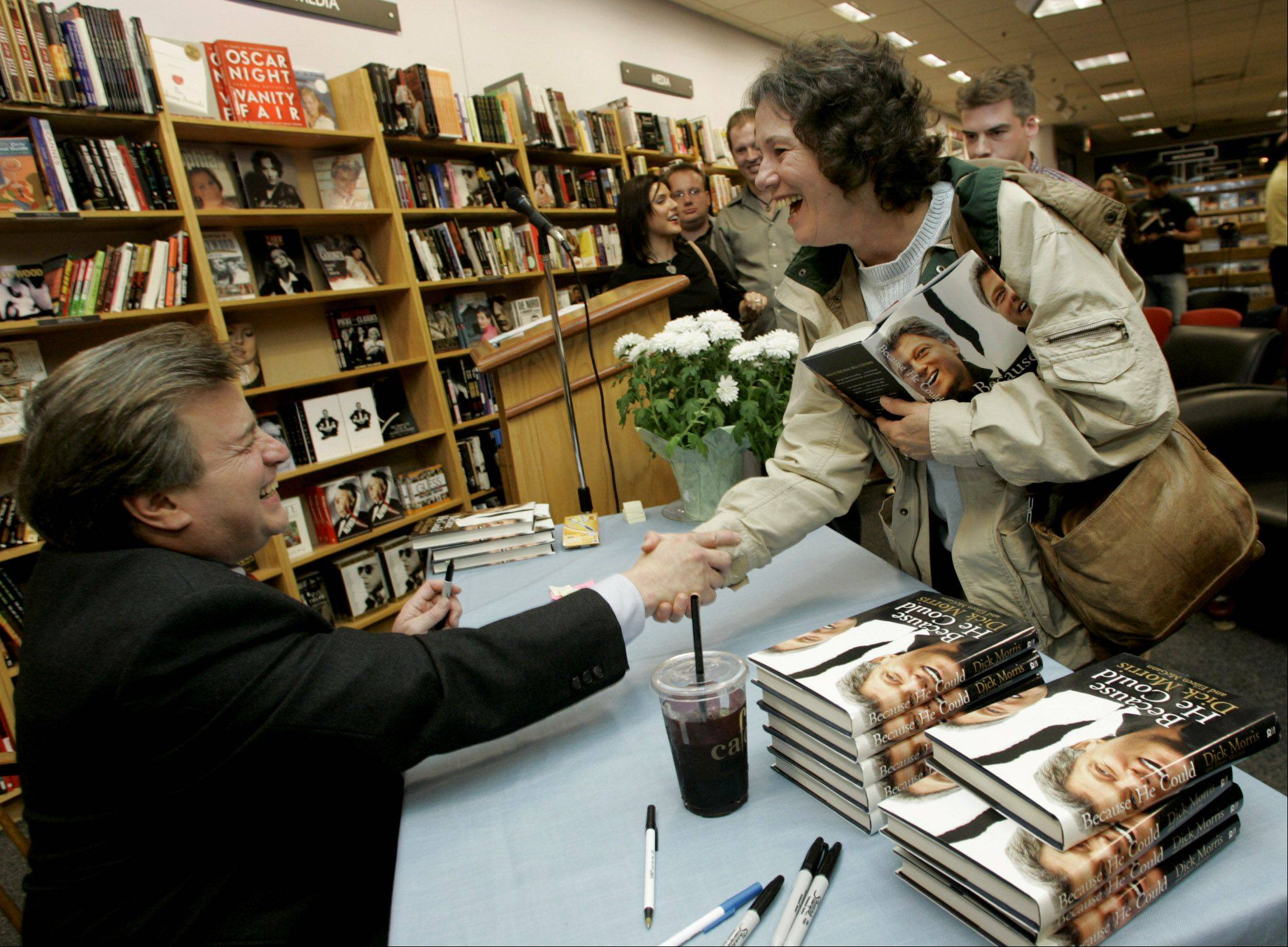 Political analyst Dick Morris signed books in 2004 at the Borders in Oak Brook.