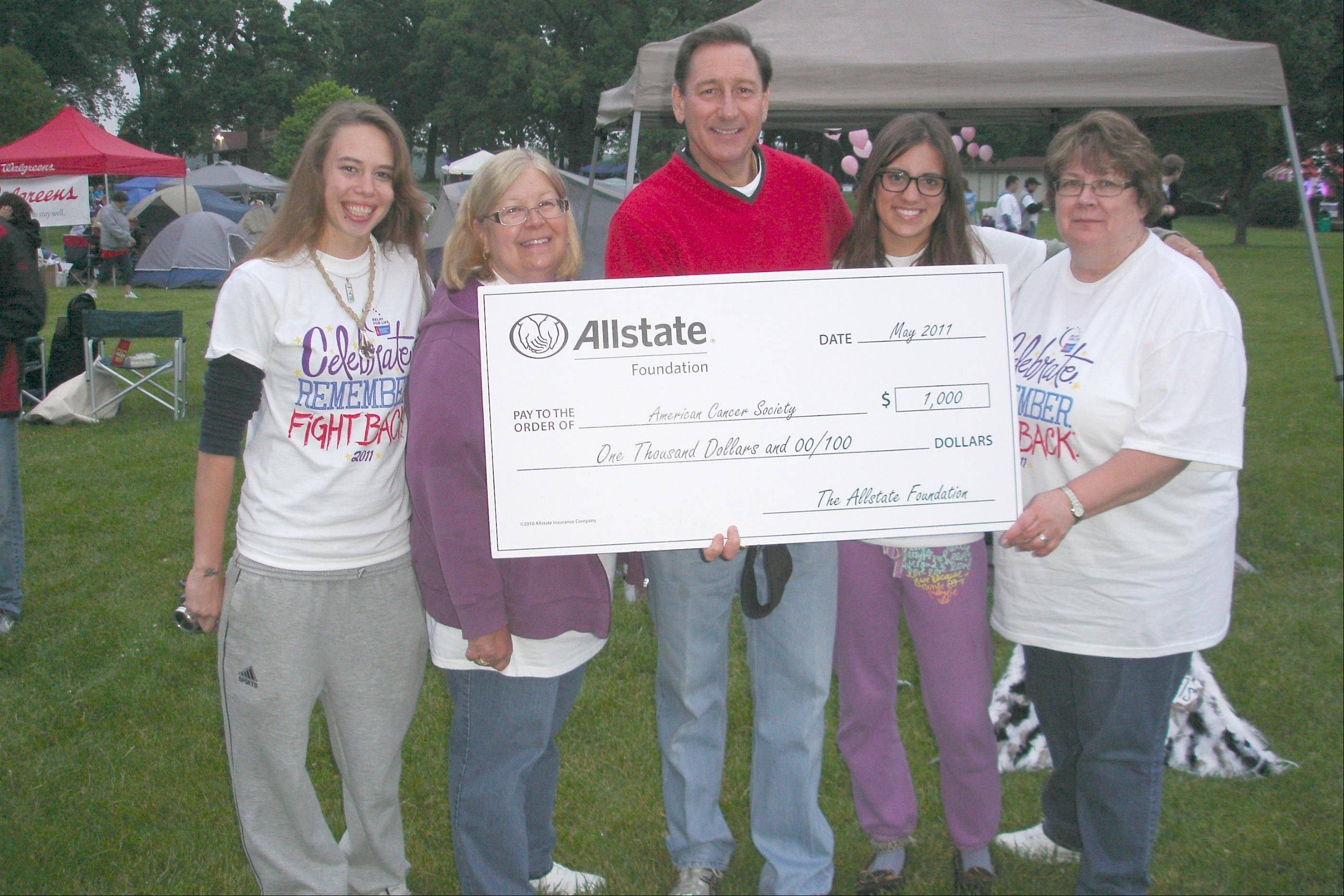 Phil Rutledge, center, is congratulated by Kati Campbell, from left Barb Crawford, Jenny Crawford and Geri Harrman.