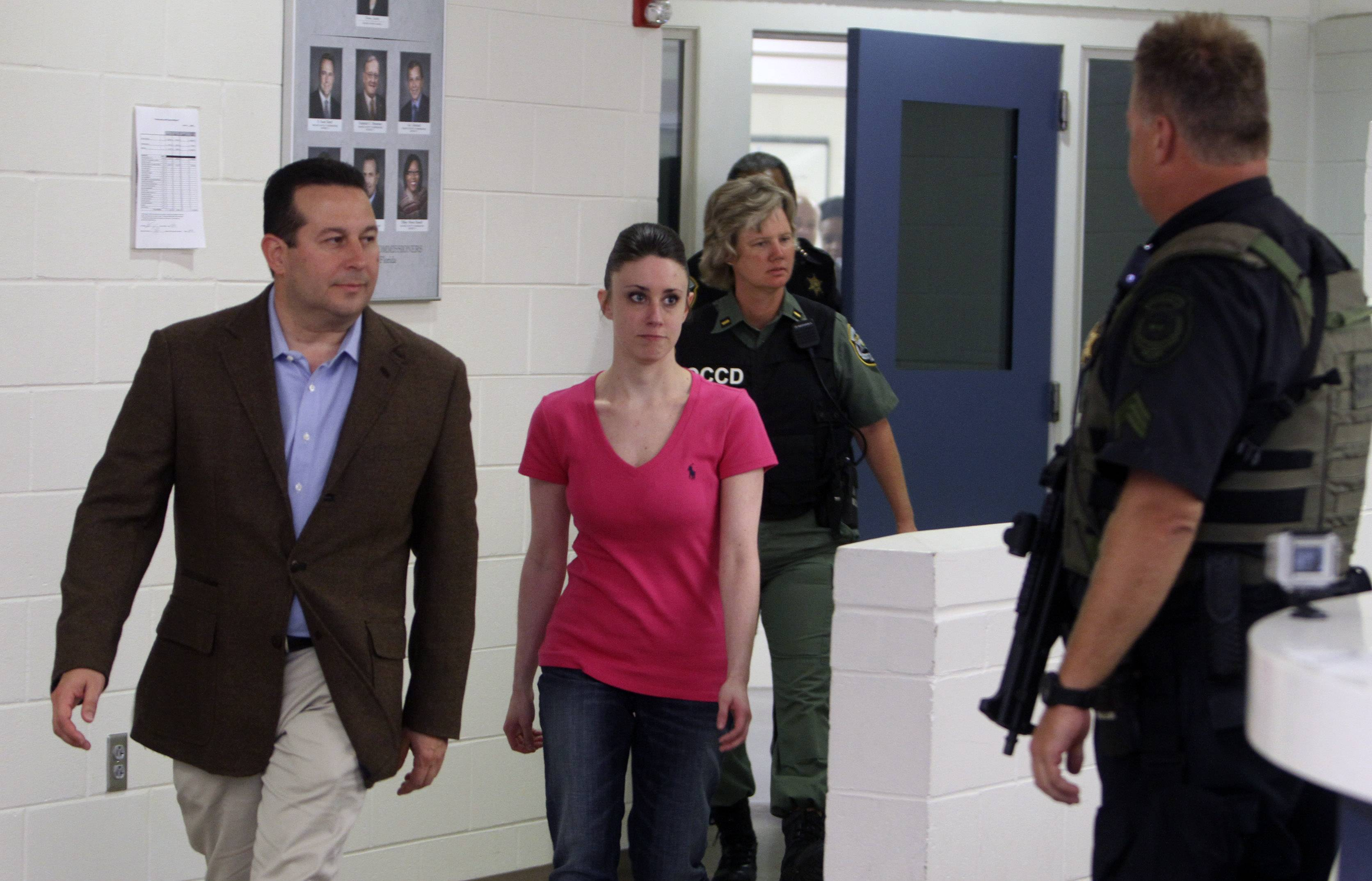 Casey Anthony walks out of the Orange County Jail with her attorney Jose Baez, left, during her release in Orlando, Fla., early Sunday, July 17. Anthony was acquitted last week of murder in the death of her daughter, Caylee.