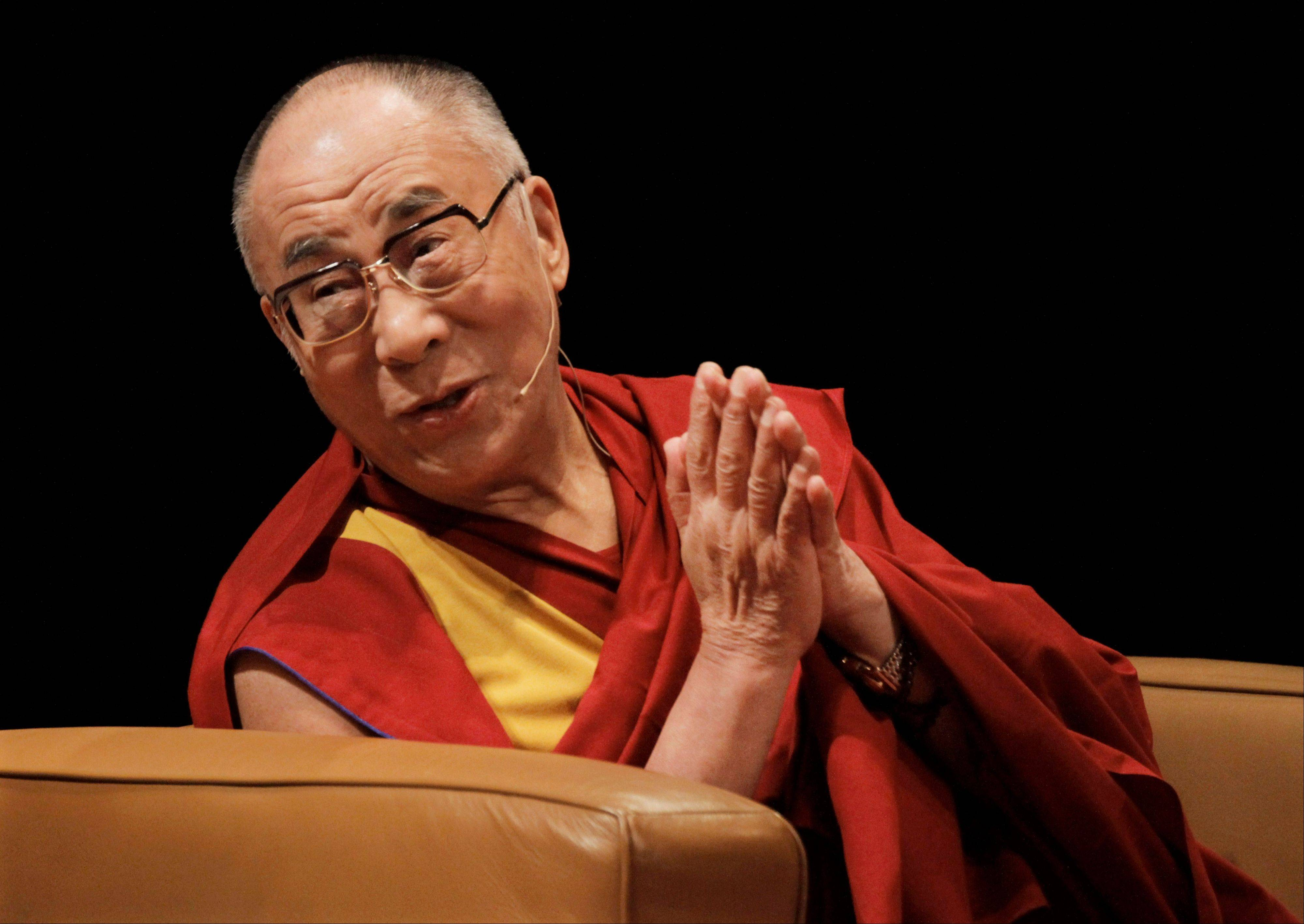 The Dalai Lama participates in a multi-faith panel discussion with Jewish, Islamic and Christian leaders Monday in Chicago. The Dalai Lama praised Illinois on Sunday for recently abolishing the death penalty.