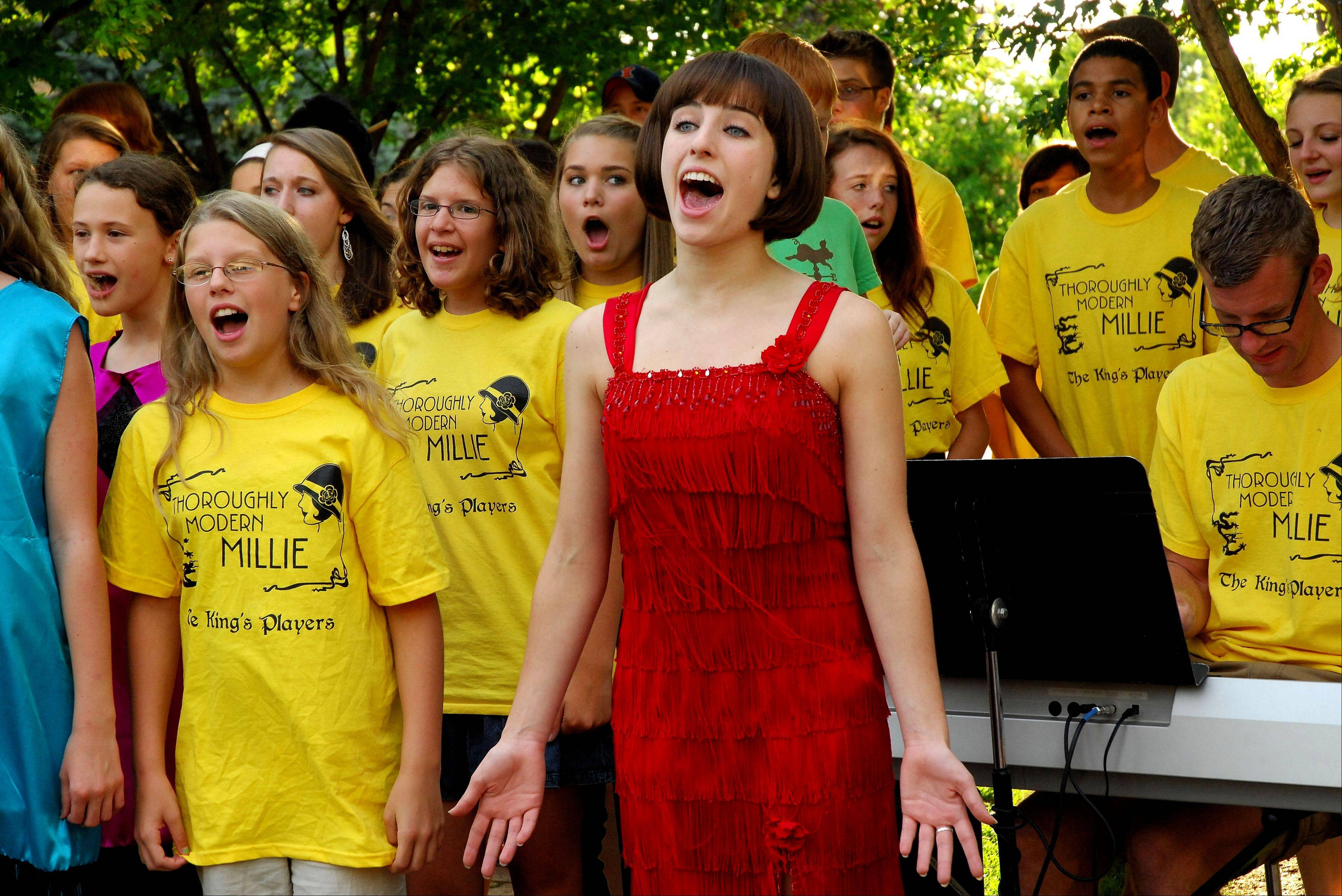 Claire LaTourette, as Millie, rehearses with the chorus.