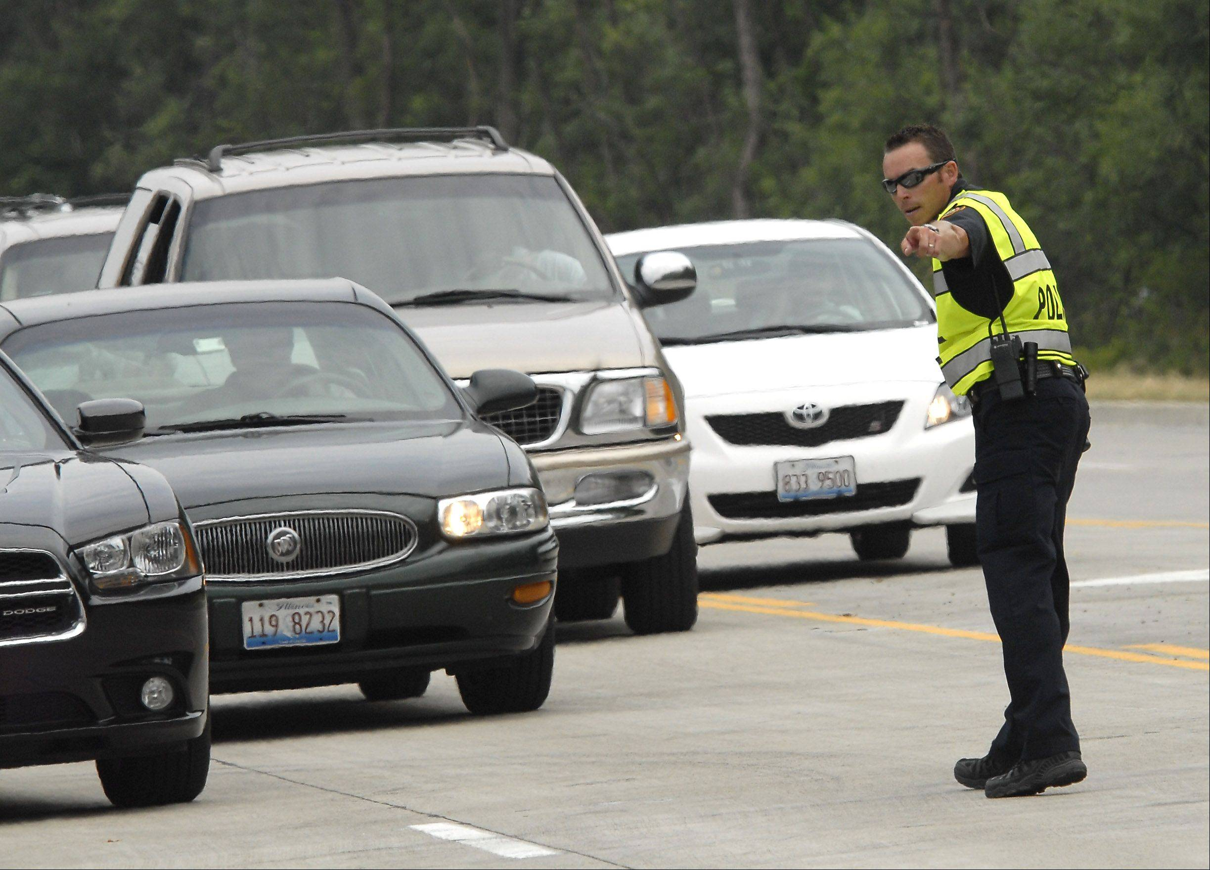 A police officer directs drivers as traffic backs up on River Road north of the Rivers Casino Monday in Des Plaines.
