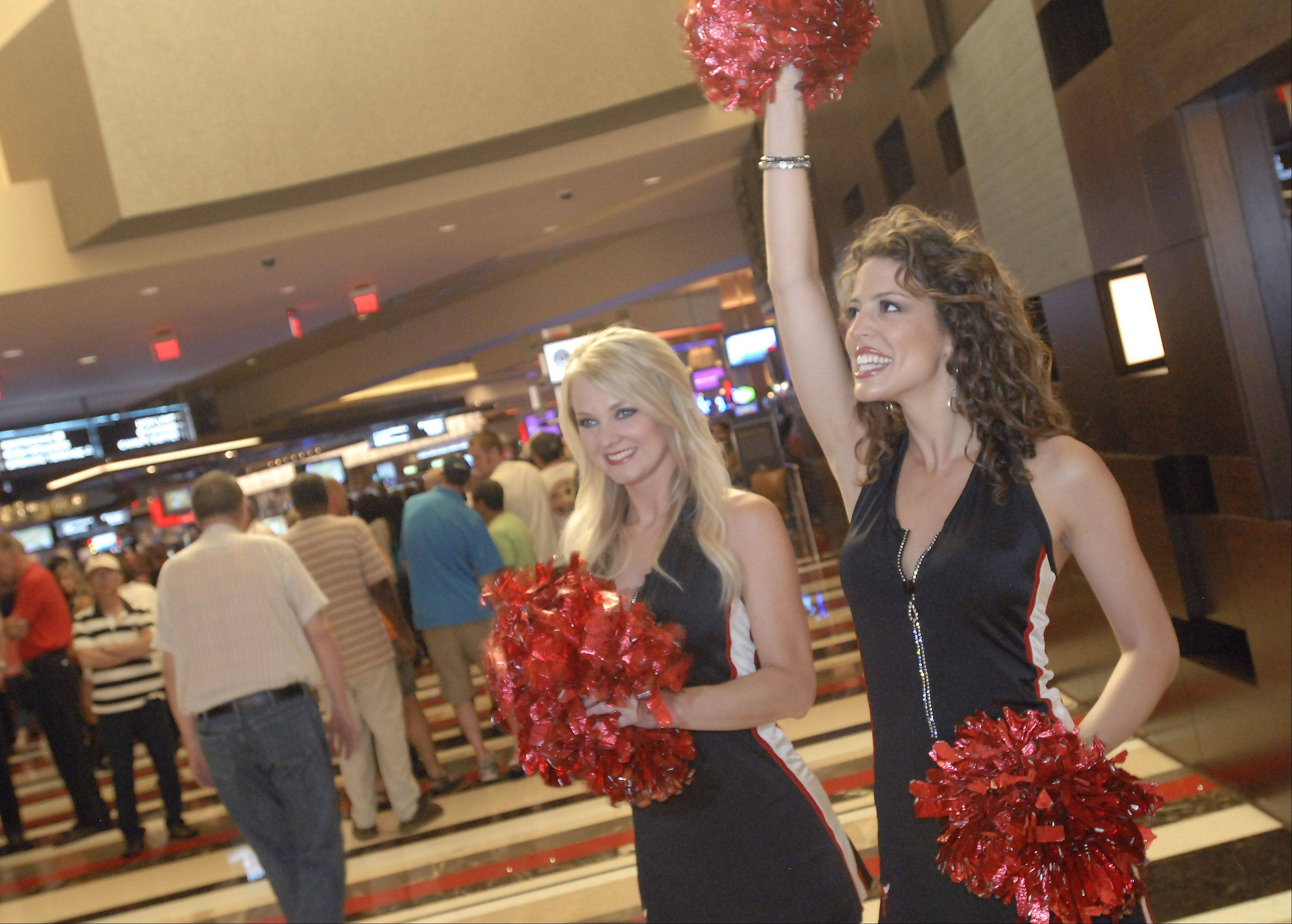 Cheerleaders greet gamblers as they enter the Rivers Casino on opening day Monday in Des Plaines.