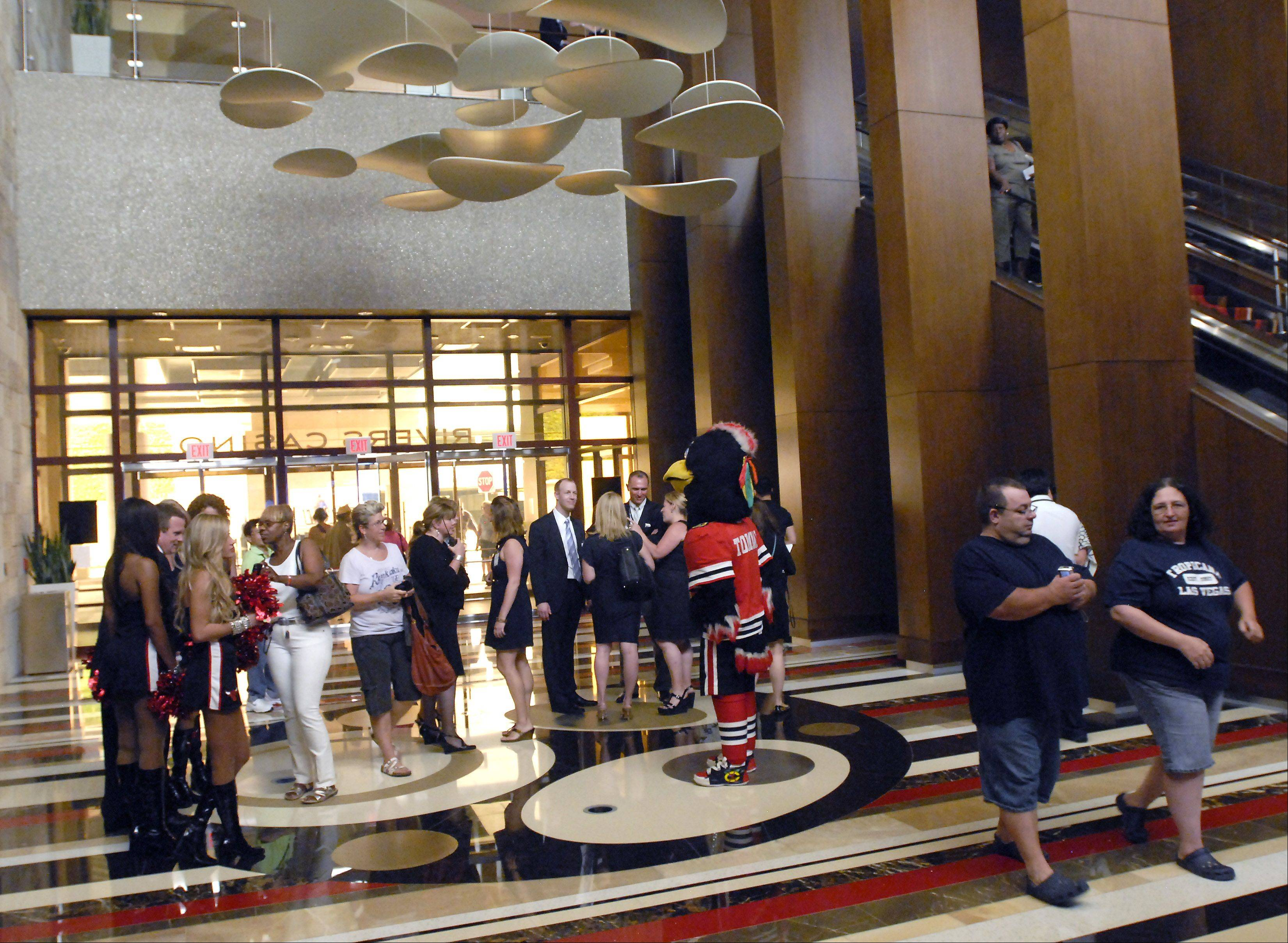 Players enter the lobby during the grand opening of the Rivers Casino Monday in Des Plaines.
