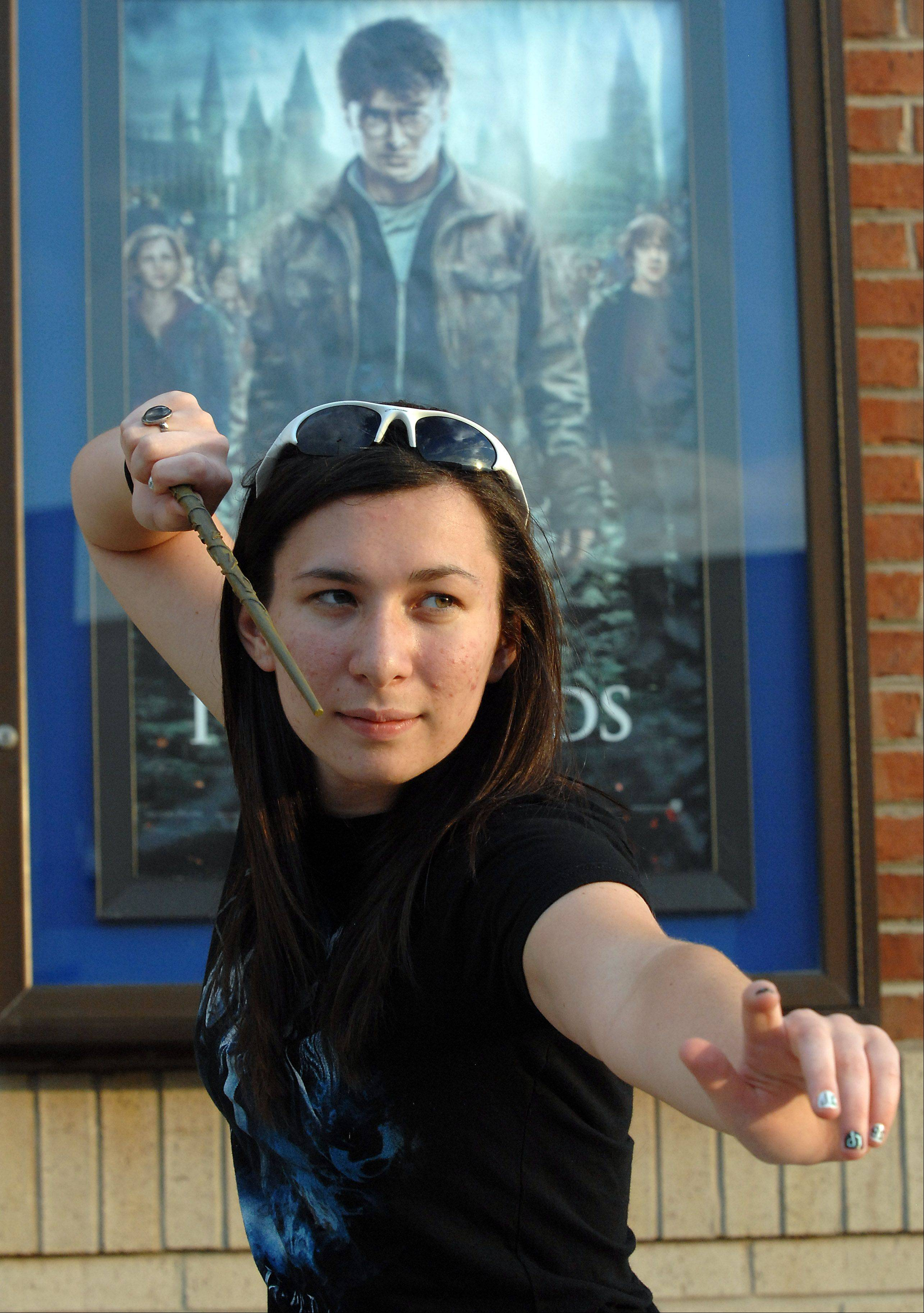 Erika Bauer,18, of Elk Grove Village gets ready to cast her magic spell with her Harry Potter wand getting ready to view the final installment of the Harry Potter series at the Elk Grove Cinema on Thursday night.