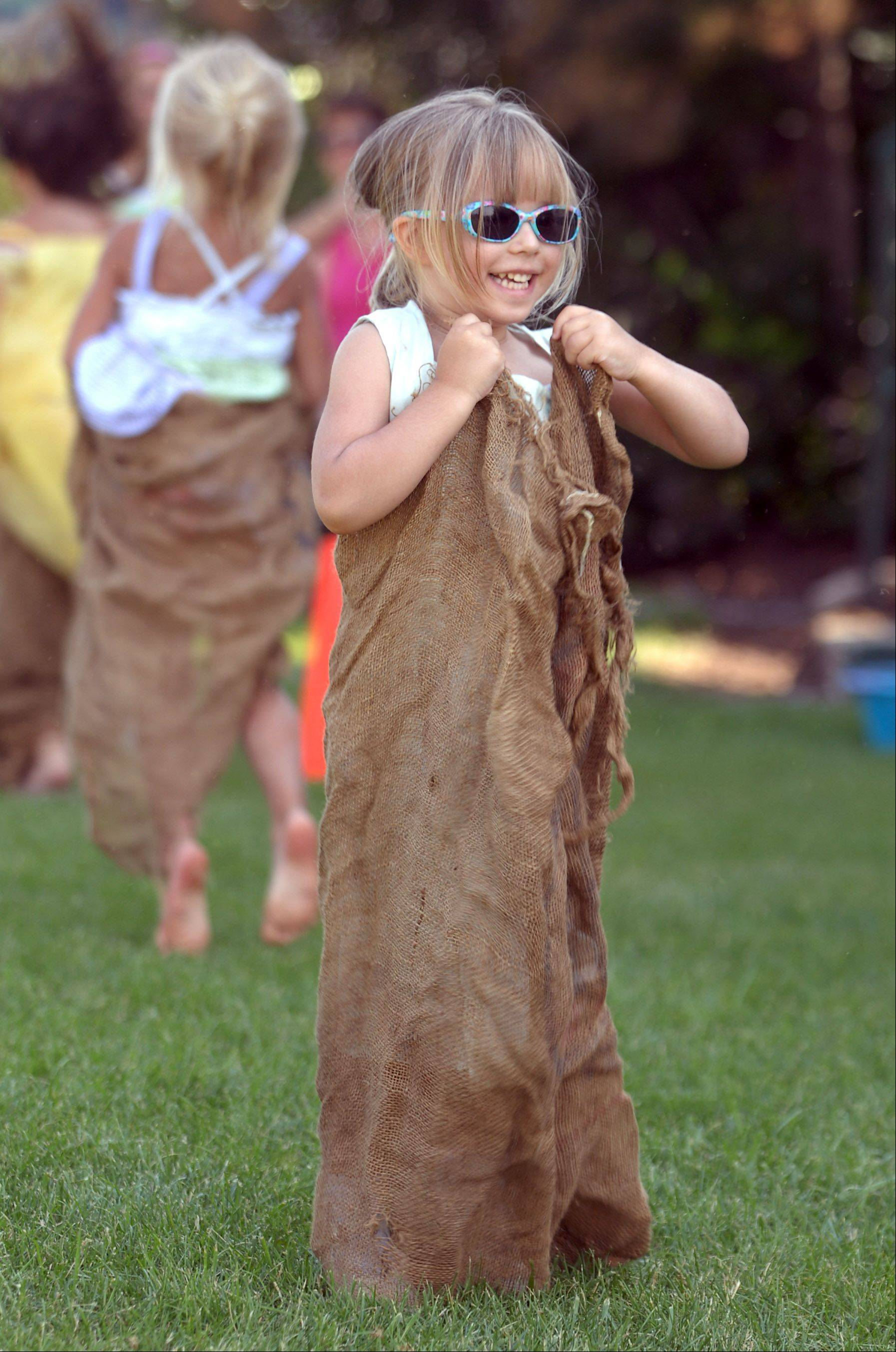 Erin Pasdiora, 4 of Antioch, participates in sack races Thursday afternoon during the first day of Antioch's Taste of Summer. The event continues through Sunday with food, rides, games and entertainment.