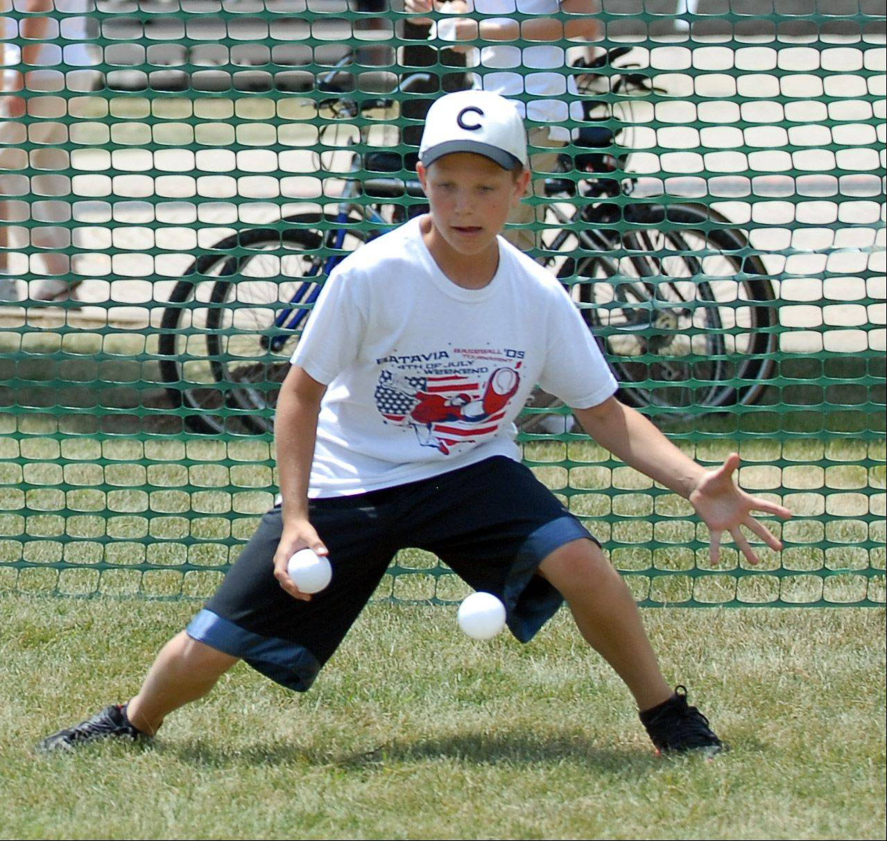 On Saturday, Matthew Henkel, 13, of Batavia catches a ball during the wiffle ball tournament at Batavia's Windmill City Festival.
