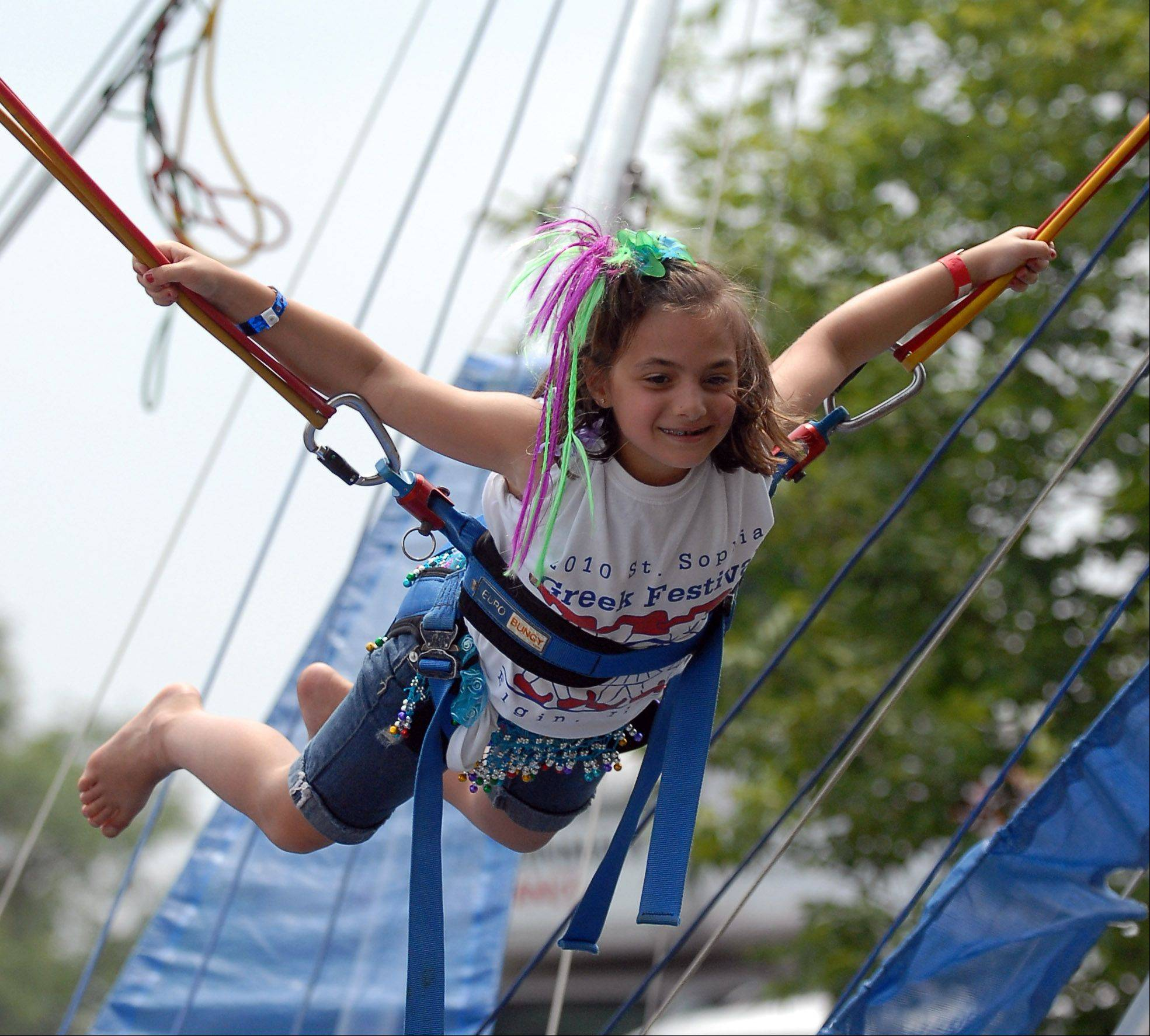 On Sunday, Stella Frangiadakis, 8, of Arlington Heights, enjoyed the kids bungee activity at the St. Sophia Greek Orthodox Church's 33rd-annual Greek Festival in Elgin. Stella attended the event with her father, Zach Frangiadakis of Arlington Heights. They are both members of the church.
