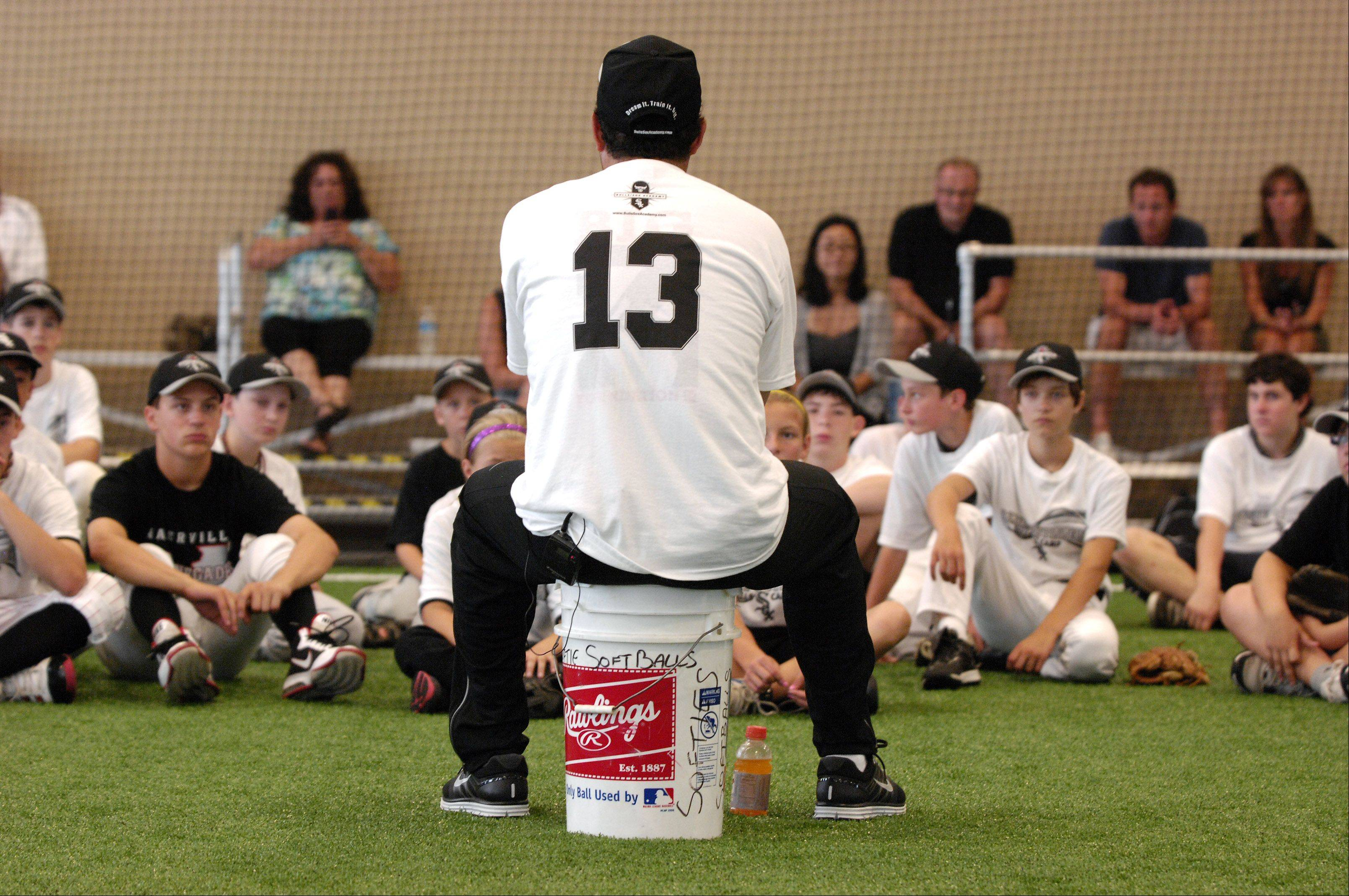 Chicago White Sox manager Ozzie Guillen gives some words of wisdom to kids attending the Bulls/Sox Academy in Glen Ellyn. Guillen had spent the morning working on baseball skills with the kids.