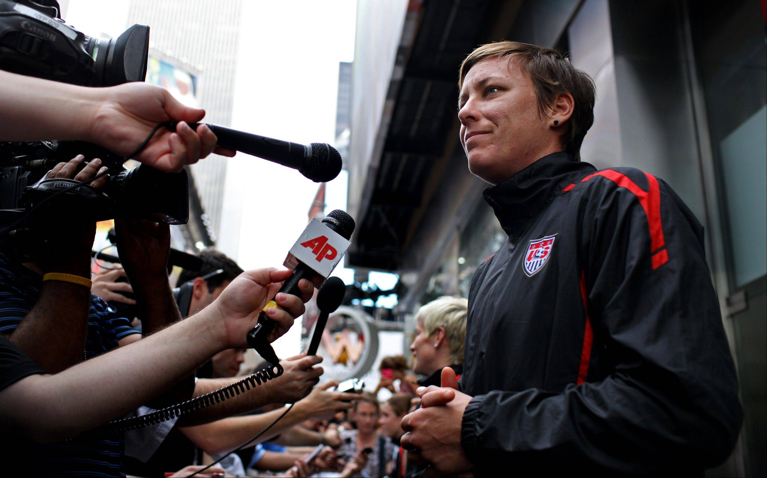Abby Wambach, talking to reporters in New York's Times Square on Monday after the team's return from Germany, says its too early to think about her future with the U.S. team.